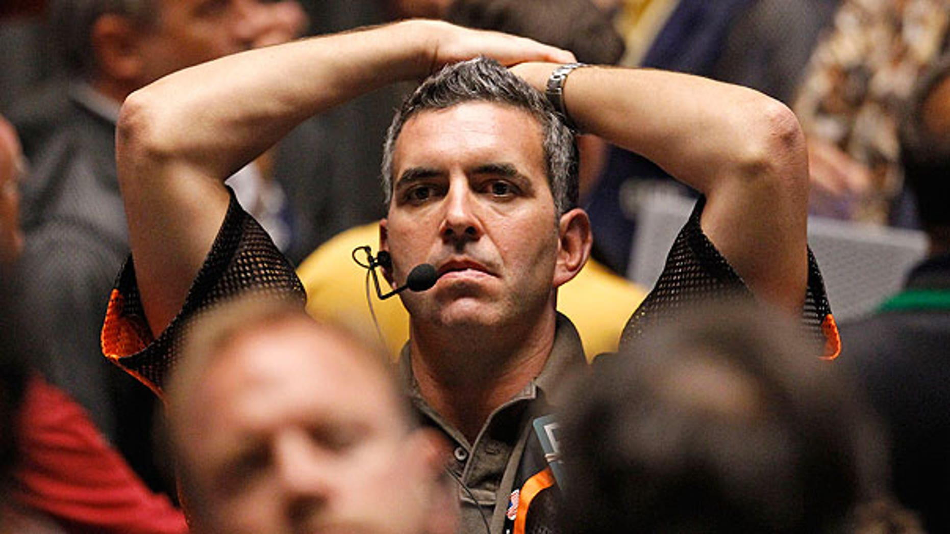 Aug. 8: Trader Patrick Garveyreacts after the close of trading in the S&P 500 Futures pit, on the floor of The CME Group in Chicago.