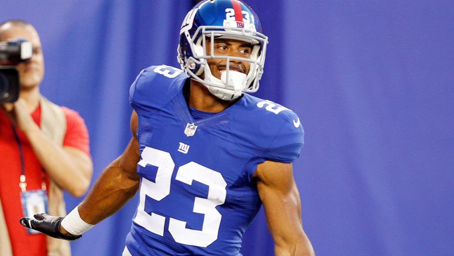 Aug 9, 2014; East Rutherford, USA; New York Giants running back Rashad Jennings (23) celebrates after scoring a touchdown against the Pittsburgh Steelers during the preseason game at MetLife Stadium. Mandatory Credit: William Perlman/THE STAR-LEDGER via USA TODAY Sports