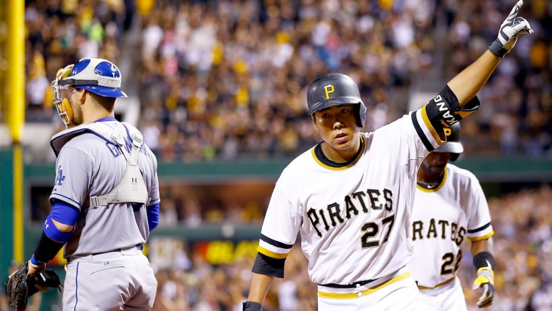 PITTSBURGH, PA - AUGUST 09: Jung Ho Kang #27 of the Pittsburgh Pirates celebrates his three run home run in the 7th inning against the Los Angeles Dodgers during the game at PNC Park on August 9, 2015 in Pittsburgh, Pennsylvania. (Photo by Jared Wickerham/Getty Images)