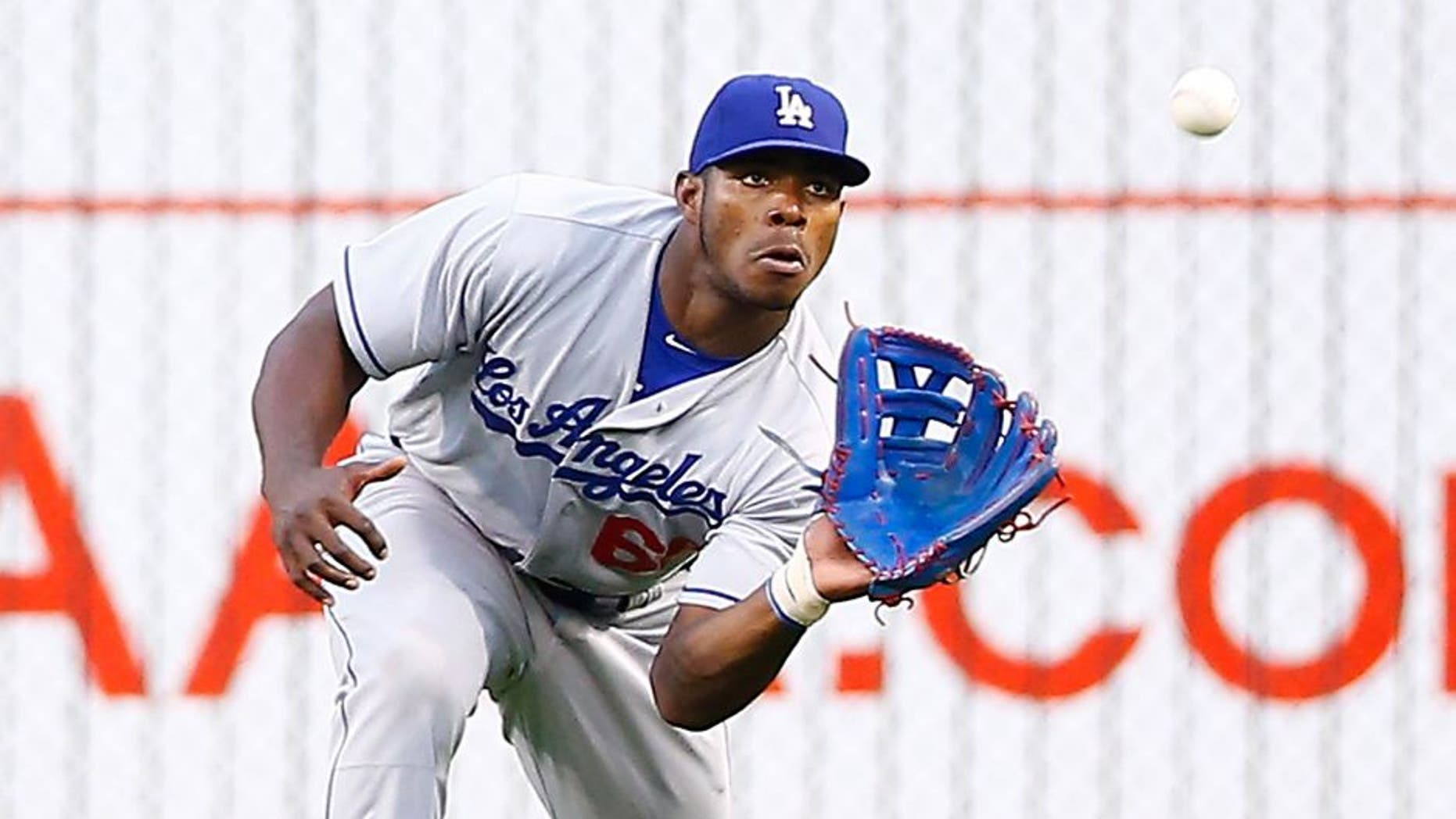 PITTSBURGH, PA - AUGUST 08: Yasiel Puig #66 of the Los Angles Dodgers catches a fly ball in right field against the Pittsburgh Pirates during the game at PNC Park on August 8, 2015 in Pittsburgh, Pennsylvania. (Photo by Jared Wickerham/Getty Images)