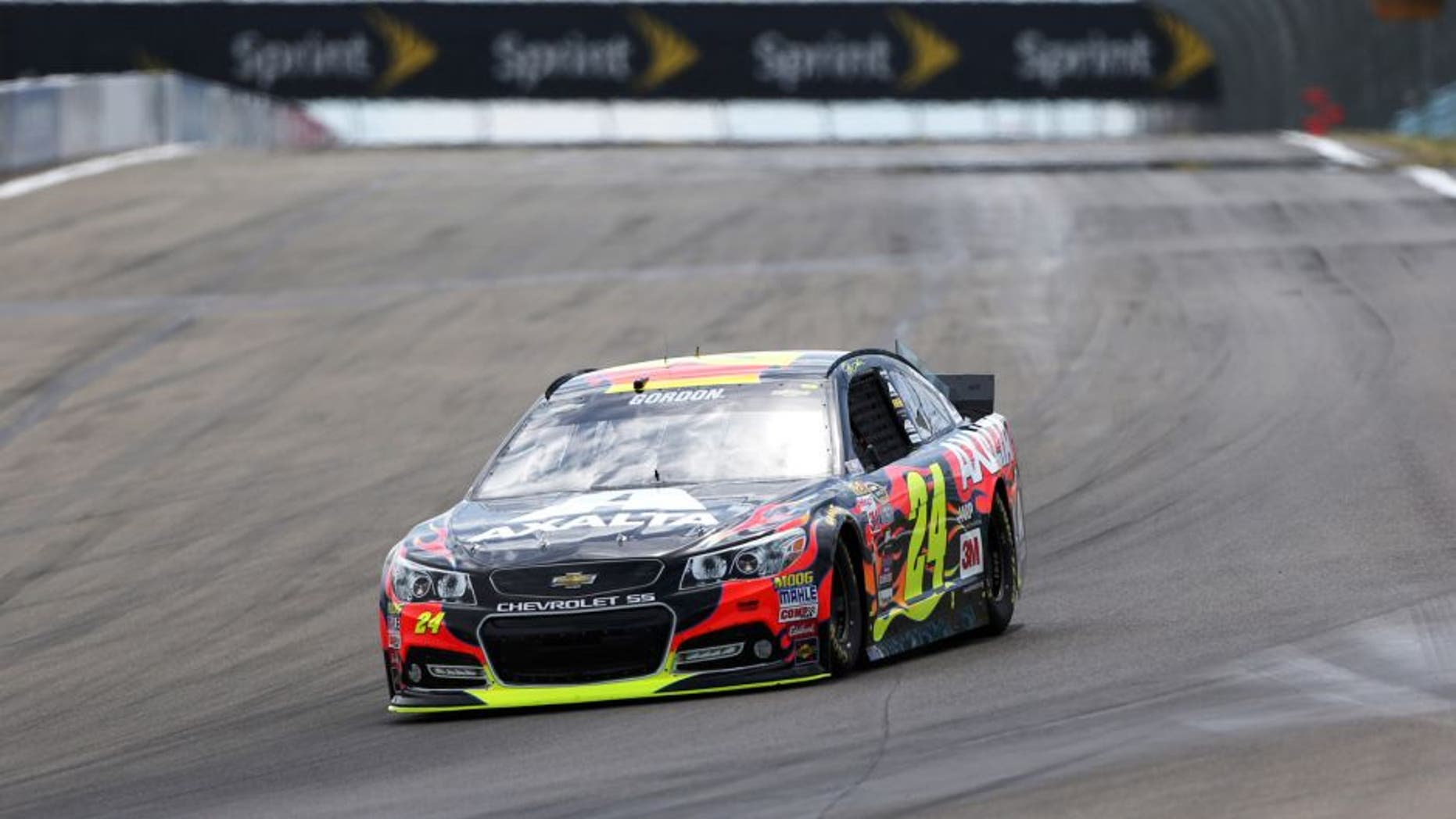 WATKINS GLEN, NY - AUGUST 08: Jeff Gordon, driver of the #24 Axalta Chevrolet, races during qualifying for the NASCAR Sprint Cup Series Cheez-It 355 at Watkins Glen International on August 8, 2015 in Watkins Glen, New York. (Photo by Todd Warshaw/Getty Images)
