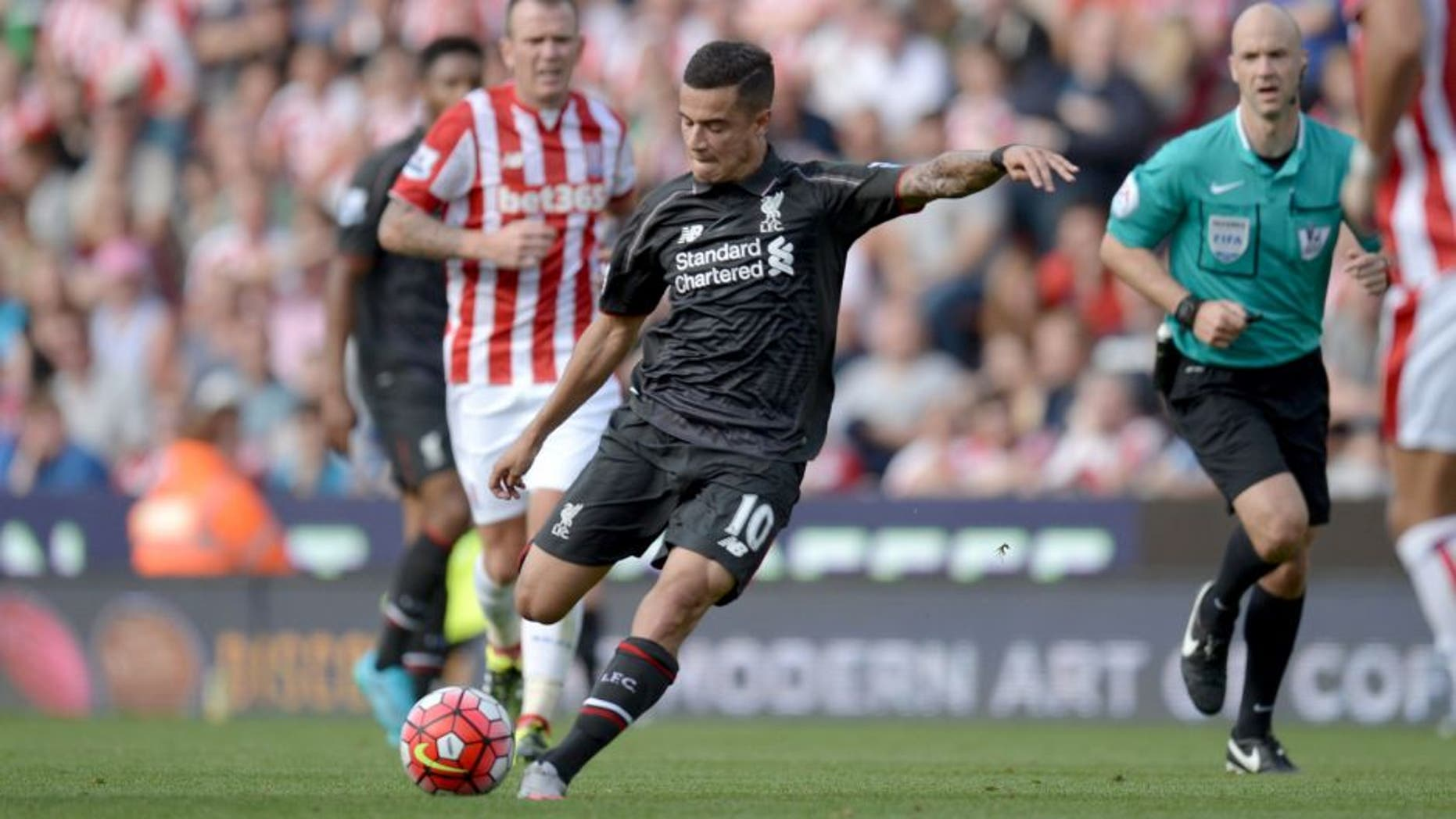 Liverpool's Brazilian midfielder Philippe Coutinho shoots to score the opening goal of the English Premier League football match between Stoke City and Liverpool at the Britannia Stadium in Stoke-on-Trent, central England on August 9, 2015. AFP PHOTO / OLI SCARFF RESTRICTED TO EDITORIAL USE. No use with unauthorized audio, video, data, fixture lists, club/league logos or 'live' services. Online in-match use limited to 75 images, no video emulation. No use in betting, games or single club/league/player publications.. (Photo credit should read OLI SCARFF/AFP/Getty Images)