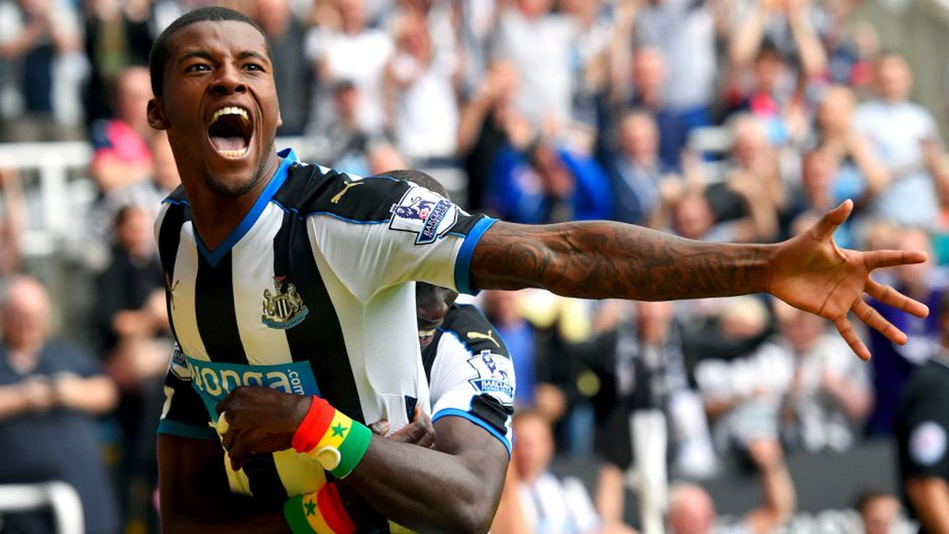 NEWCASTLE UPON TYNE, ENGLAND - AUGUST 09: Georginio Wijnaldum of Newcastle United celebrates scoring their second goal with Papiss Demba Cisse of Newcastle United during the Barclays Premier League match between Newcastle United and Southampton at St James' Park on August 9, 2015 in Newcastle upon Tyne, England. (Photo by Stu Forster/Getty Images)