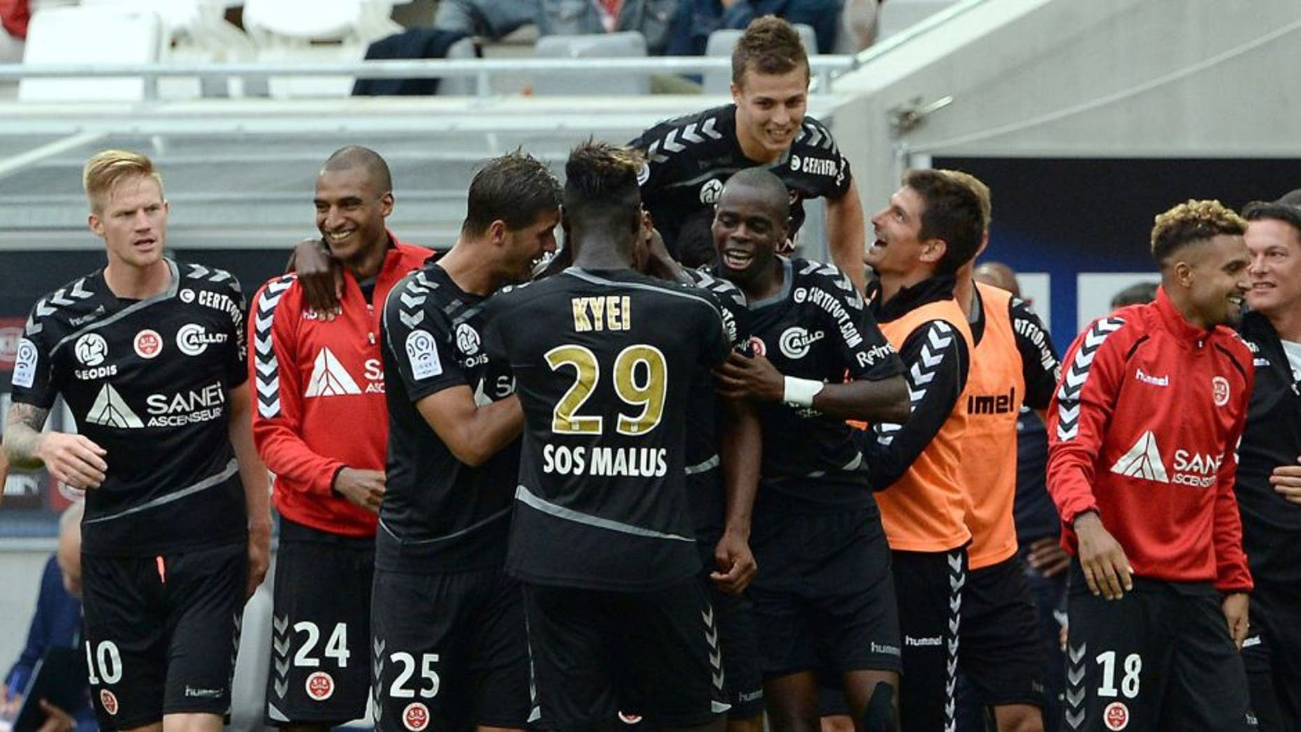 Reims' players celebrate after scoring a goal during the French L1 football match between Bordeaux and Reims at the new Stade in Bordeaux, southwestern France, on August 9, 2015. AFP PHOTO / JEAN PIERRE MULLER (Photo credit should read JEAN PIERRE MULLER/AFP/Getty Images)