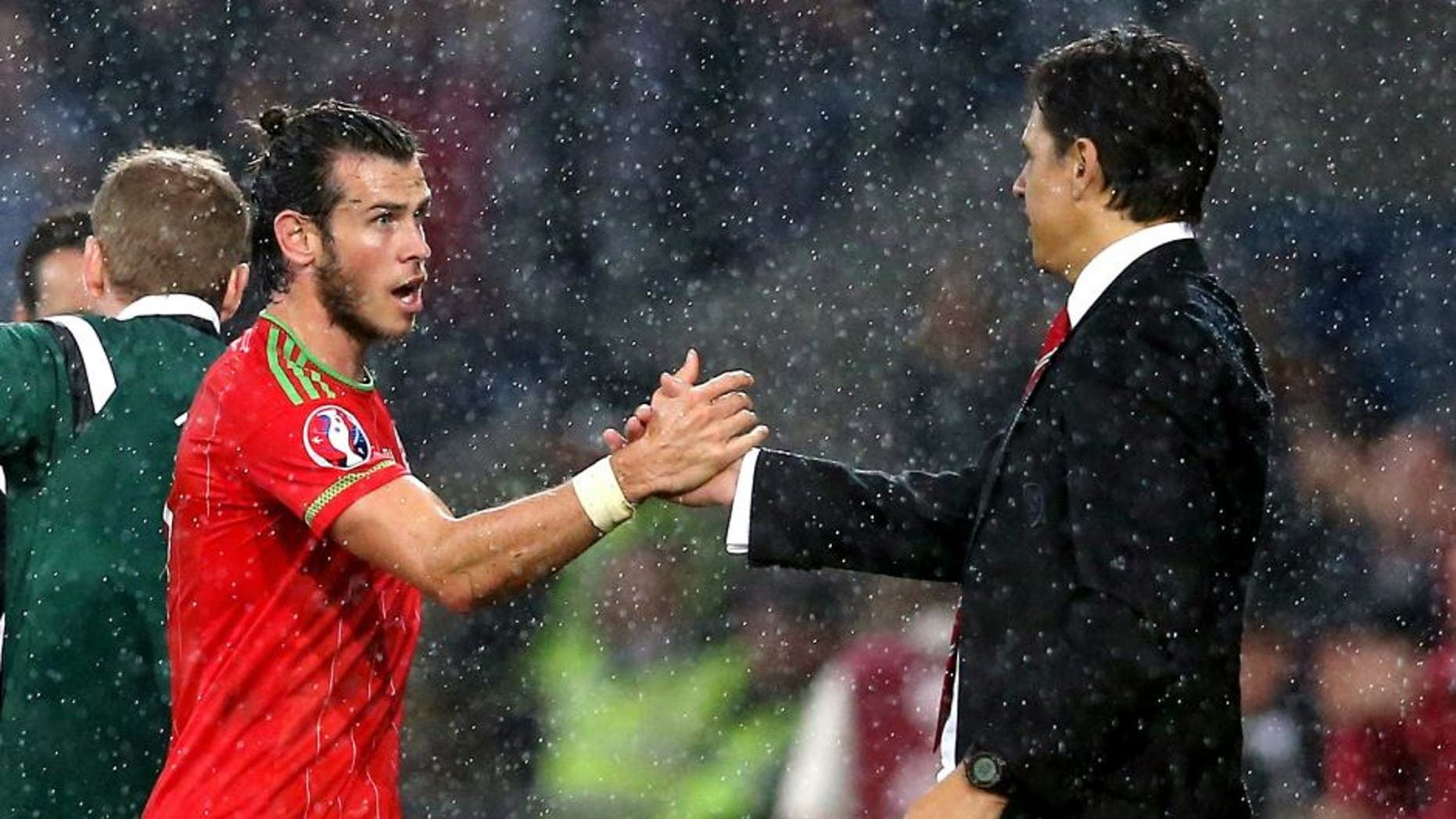 CARDIFF, WALES - JUNE 12: Gareth Bale of Wales, who scored the winning goal shakes hands with Wales manager Chris Coleman as he is subsituted during the UEFA EURO 2016 qualifying match between Wales and Belgium at the Cardiff City Stadium on June 12, 2015 in Cardiff, United Kingdom. (Photo by David Rogers/Getty Images)