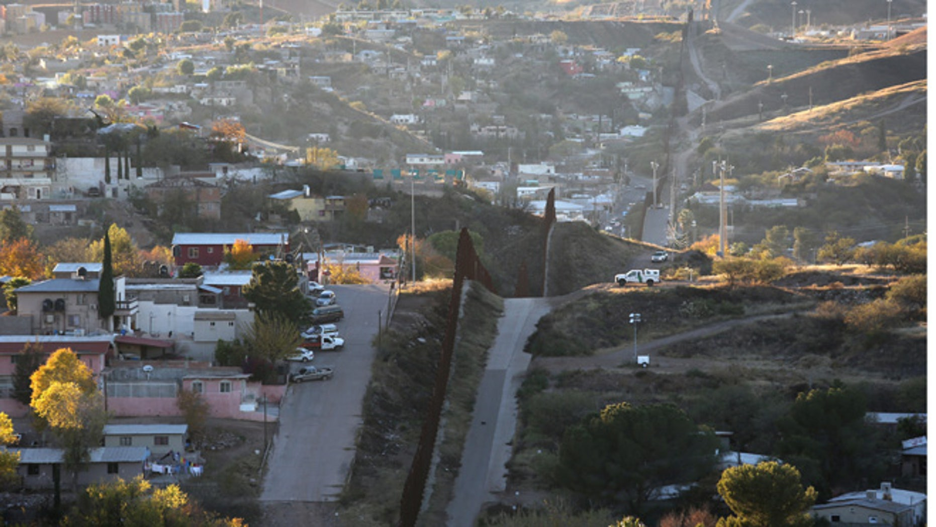 NOGALES, AZ - DECEMBER 09:  A U.S. Border Patrol agent watches over the U.S.-Mexico border fence from his vehicle on December 9, 2014 in Nogales, Arizona. With increased manpower and funding in recent years, the Border Patol has seen the number illegal crossings and apprehensions of undocumented immigrants decrease in the Tucson sector. Agents are waiting to see if the improved U.S. economy and housing construction will again draw more immigrants from the south. (Photo by John Moore/Getty Images)