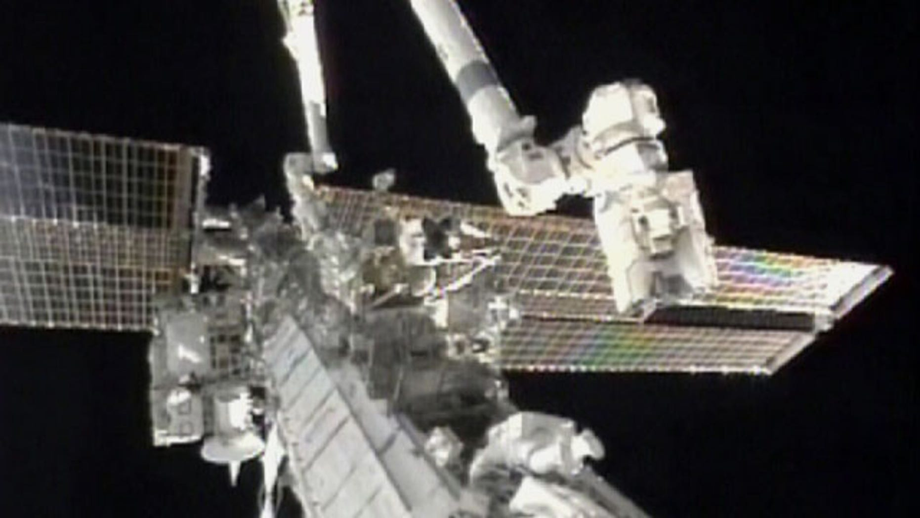 Aug. 7: In this image taken from video and made available by NASA, astronauts Douglas Wheelock, top, and Tracy Caldwell Dyson work on the International Space Station to restore a crucial cooling system.