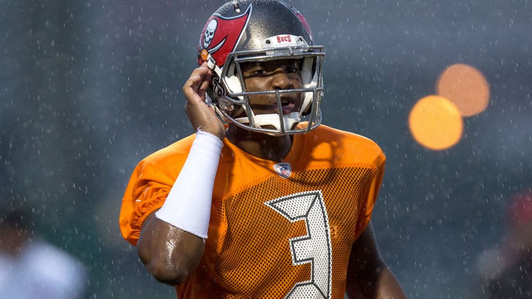 TAMPA, FL - AUGUST 1: Quarterback Jameis Winston #3 of the Tampa Bay Buccaneers works out during the first day of Training Camp at the University of South Florida on August 1, 2015 in Tampa, Florida. (Photo by Don Juan Moore/Getty Images)