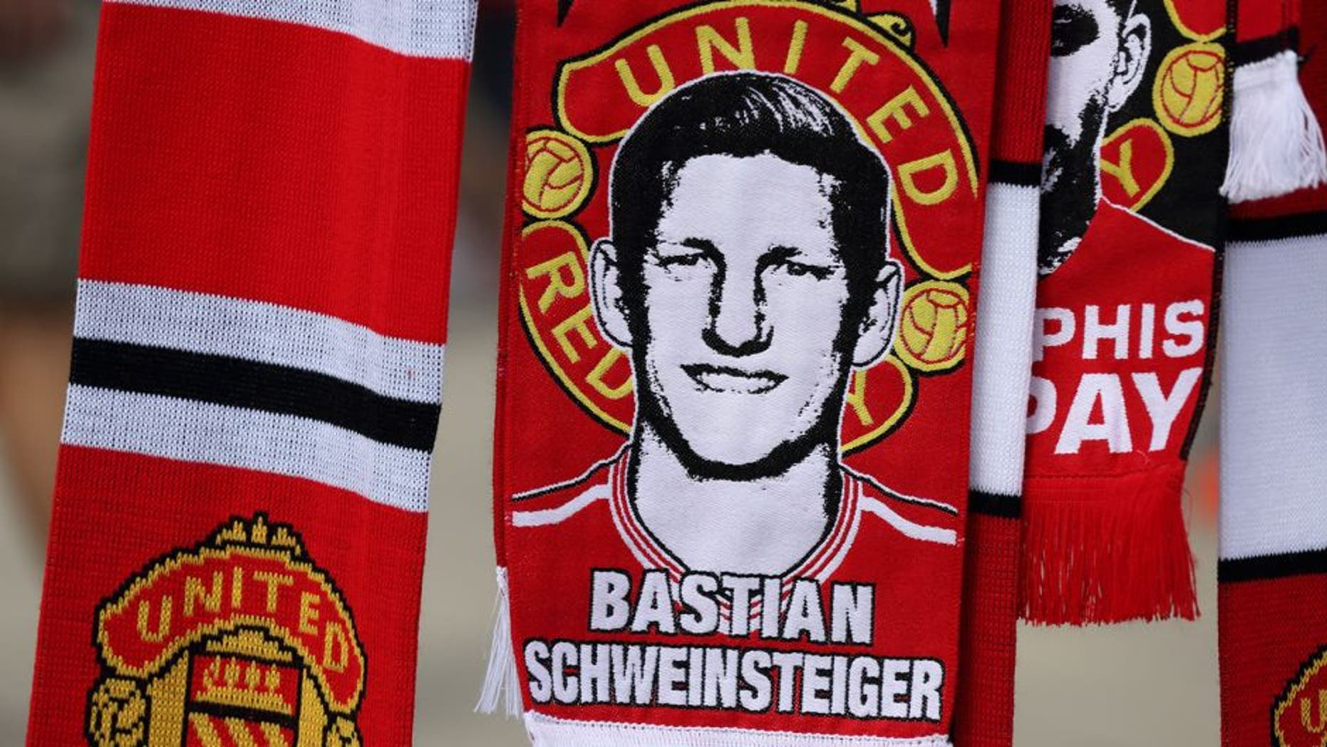 MANCHESTER, ENGLAND - AUGUST 08: A scarf of Bastian Schweinsteiger of Manchester United before the Barclays Premier League match between Manchester United and Tottenham Hotspur at Old Trafford on August 08, 2015 in Manchester, England. (Photo by Matthew Ashton - AMA/Getty Images)