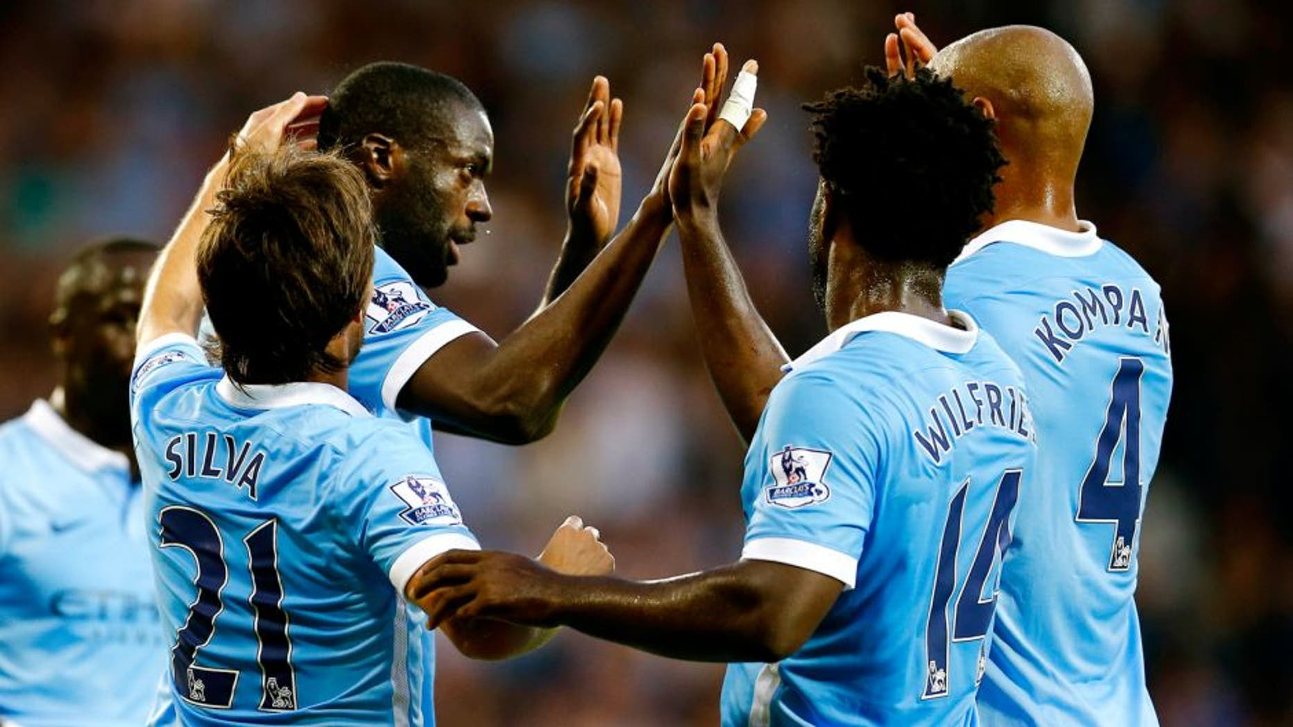 "Football - West Bromwich Albion v Manchester City - Barclays Premier League - The Hawthorns - 10/8/15 Yaya Toure celebrates with team mates after scoring the second goal for Manchester City Reuters / Darren Staples Livepic EDITORIAL USE ONLY. No use with unauthorized audio, video, data, fixture lists, club/league logos or ""live"" services. Online in-match use limited to 45 images, no video emulation. No use in betting, games or single club/league/player publications. Please contact your account representative for further details."