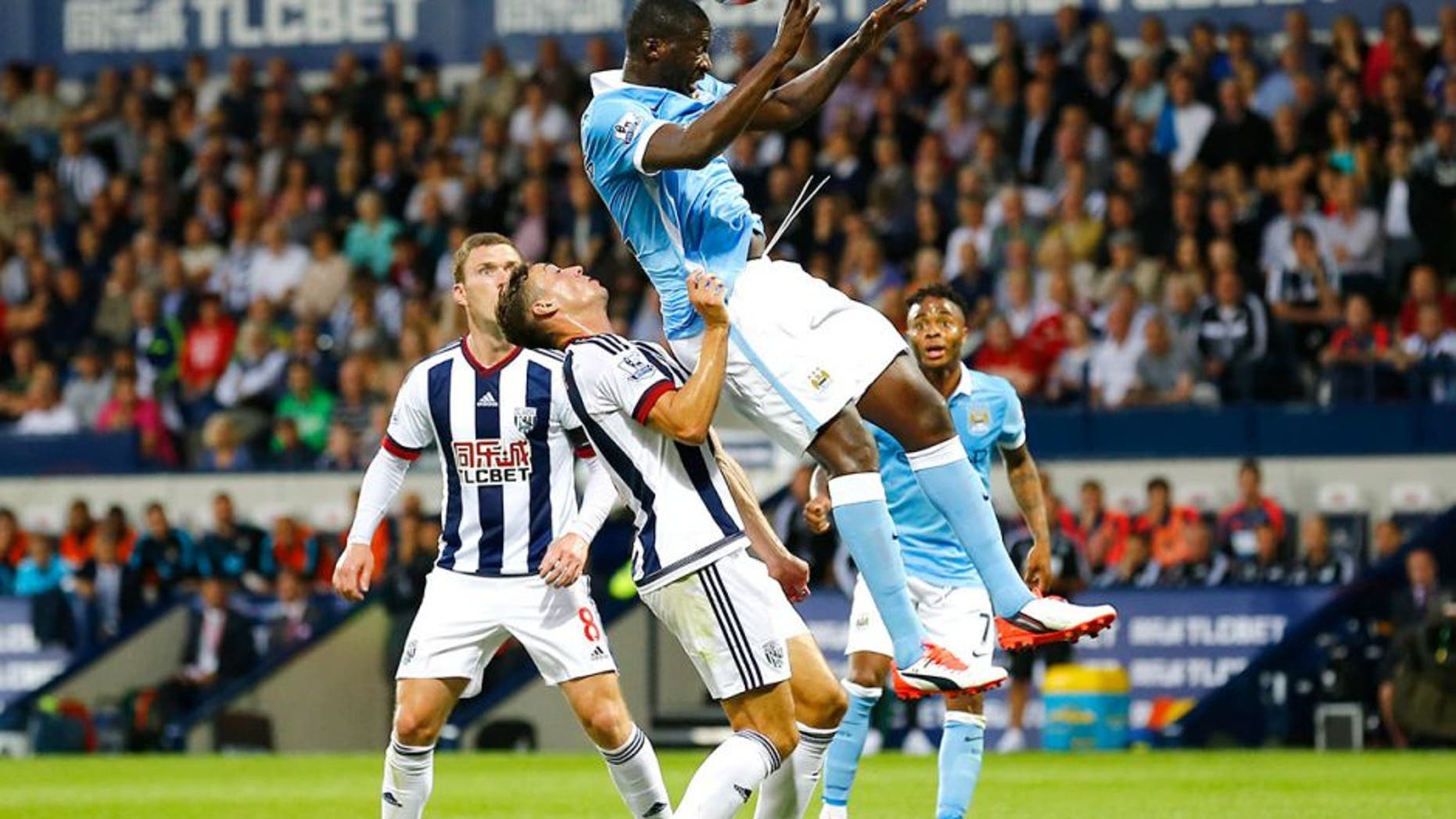"""Football - West Bromwich Albion v Manchester City - Barclays Premier League - The Hawthorns - 10/8/15 Manchester City's Yaya Toure in action with West Brom's James Chester Reuters / Darren Staples Livepic EDITORIAL USE ONLY. No use with unauthorized audio, video, data, fixture lists, club/league logos or """"live"""" services. Online in-match use limited to 45 images, no video emulation. No use in betting, games or single club/league/player publications. Please contact your account representative for further details."""