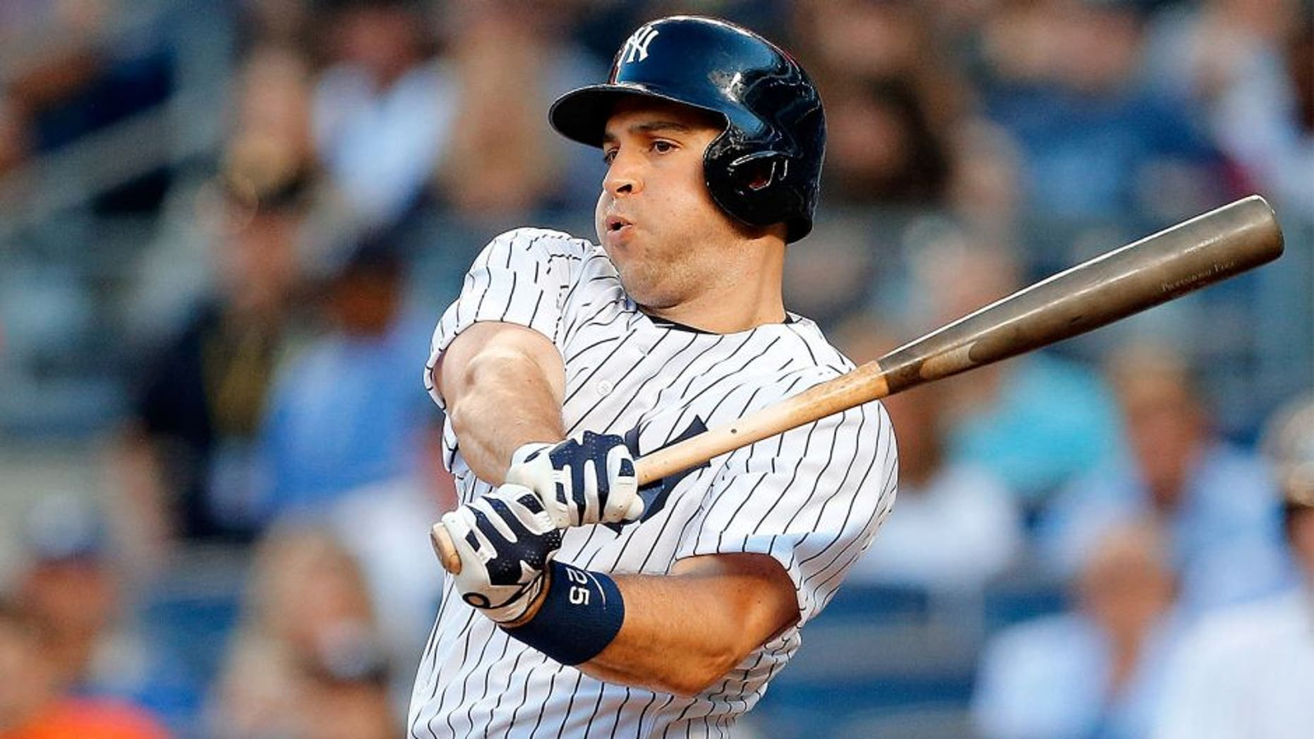NEW YORK, NY - AUGUST 04: Mark Teixeira #25 of the New York Yankees in action against the Boston Red Sox at Yankee Stadium on August 4, 2015 in the Bronx borough of New York City. The Yankees defeated the Red Sox 13-3. (Photo by Jim McIsaac/Getty Images)