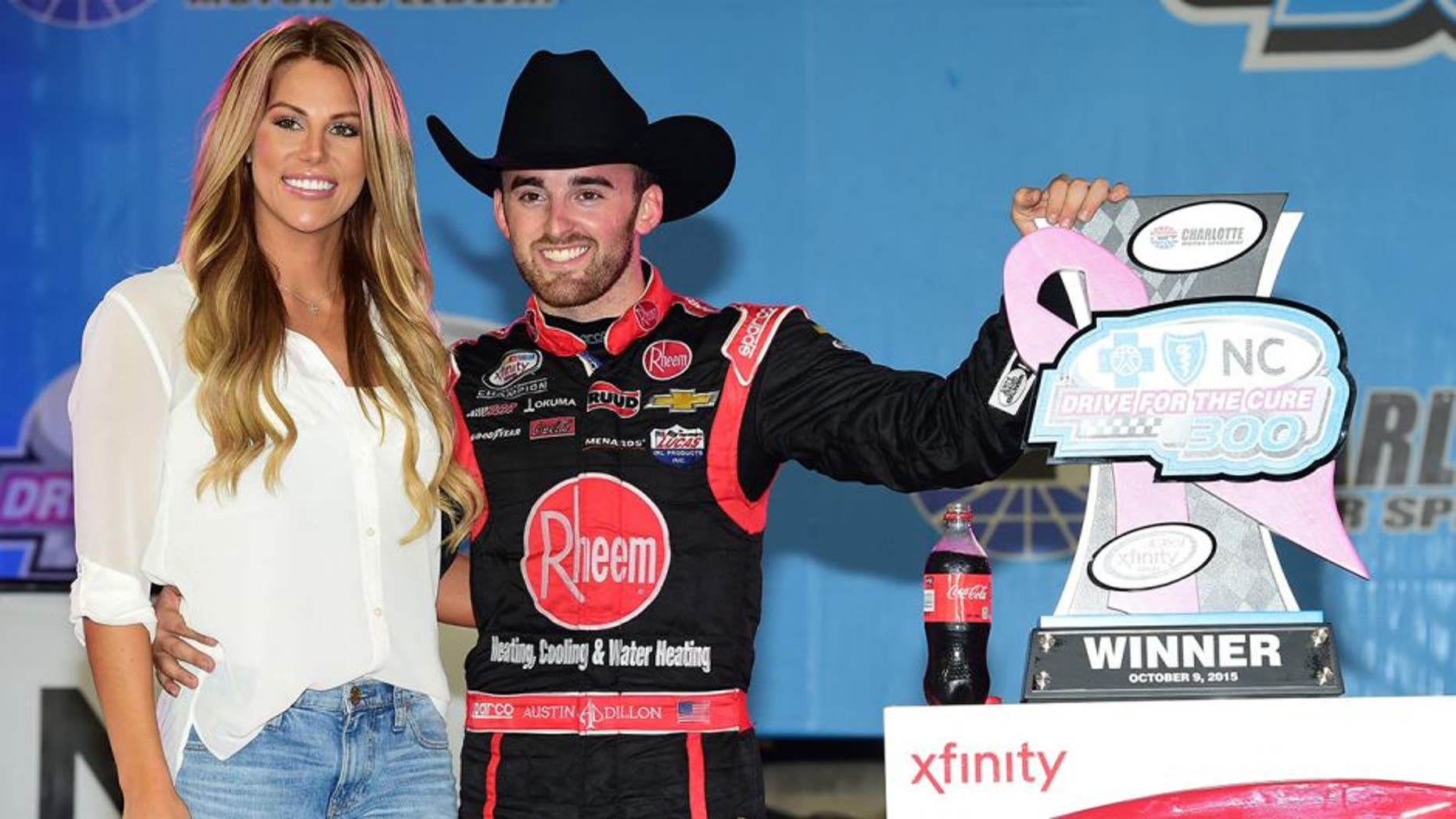 CHARLOTTE, NC - OCTOBER 09: Austin Dillon, driver of the #33 Rheem Chevrolet, celebrates in victory lane with his girlfriend and Titans cheerleader Whitney Ward after winning the NASCAR XFINITY Series Drive for the Cure 300 at Charlotte Motor Speedway on October 9, 2015 in Charlotte, North Carolina. (Photo by Jared C. Tilton/NASCAR via Getty Images)