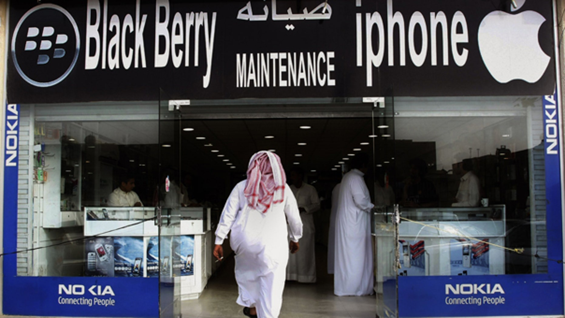 Aug. 5: A Saudi man enters a mobile shop at a market in the capital Riyadh, Saudi Arabia. Saudi and Emirati authorities' battle with BlackBerry manufacturer Research in Motion shows how rapid changes in technology are sowing unease in countries where the unfettered flow of data is seen as a threat.