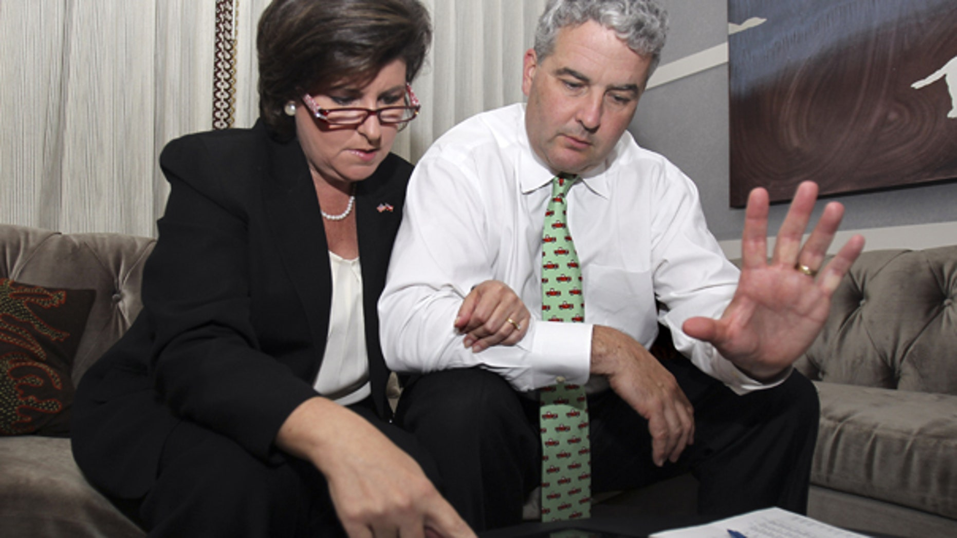 Aug. 10: Georgia gubernatorial candidate Karen Handel and her husband Steve Handel look over early returns after the polls closed Tuesday night in Atlanta.