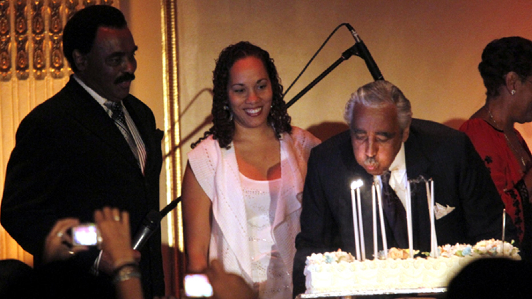 Aug. 11: Rep. Charles Rangel blows out his candles while onstage with his daughter Alicia Rangel, center, and singer Chuck Jackson during his birthday fundraiser at the Plaza Hotel in New York.