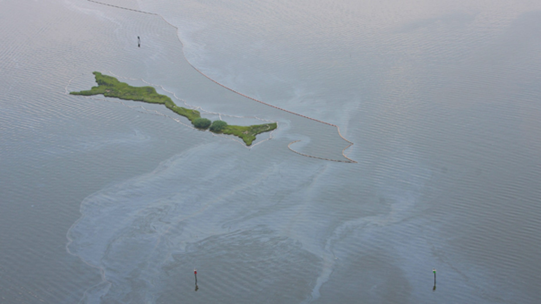 Aug. 5: Oil from the Deepwater Horizon disaster is visible in Barataria Bay. BP finished pumping fresh cement into its blown-out oil well as aimed to seal for good the ruptured pipe that for months spewed crude into Gulf of Mexico in one of the world's worst spills.
