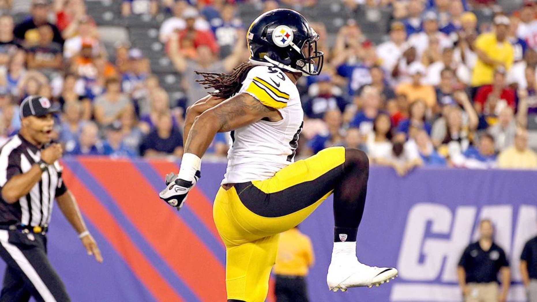Aug 9, 2014; East Rutherford, NJ, USA; Pittsburgh Steelers outside linebacker Jarvis Jones (95) celebrates after sacking New York Giants quarterback Eli Manning (10) during the first quarter at MetLife Stadium. Mandatory Credit: Adam Hunger-USA TODAY Sports