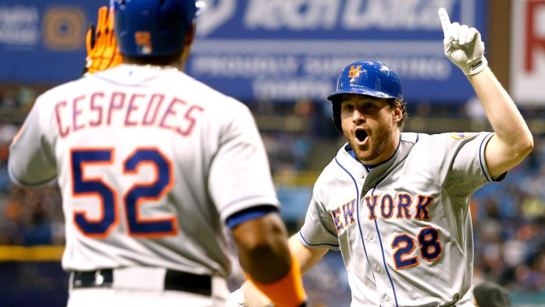 ST. PETERSBURG, FL - AUGUST 7: Daniel Murphy #28 of the New York Mets celebrates his home run with teammate Yoenis Cespedes #52 during the eighth inning of a game against the Tampa Bay Rays on August 7, 2015 at Tropicana Field in St. Petersburg, Florida. (Photo by Brian Blanco/Getty Images)