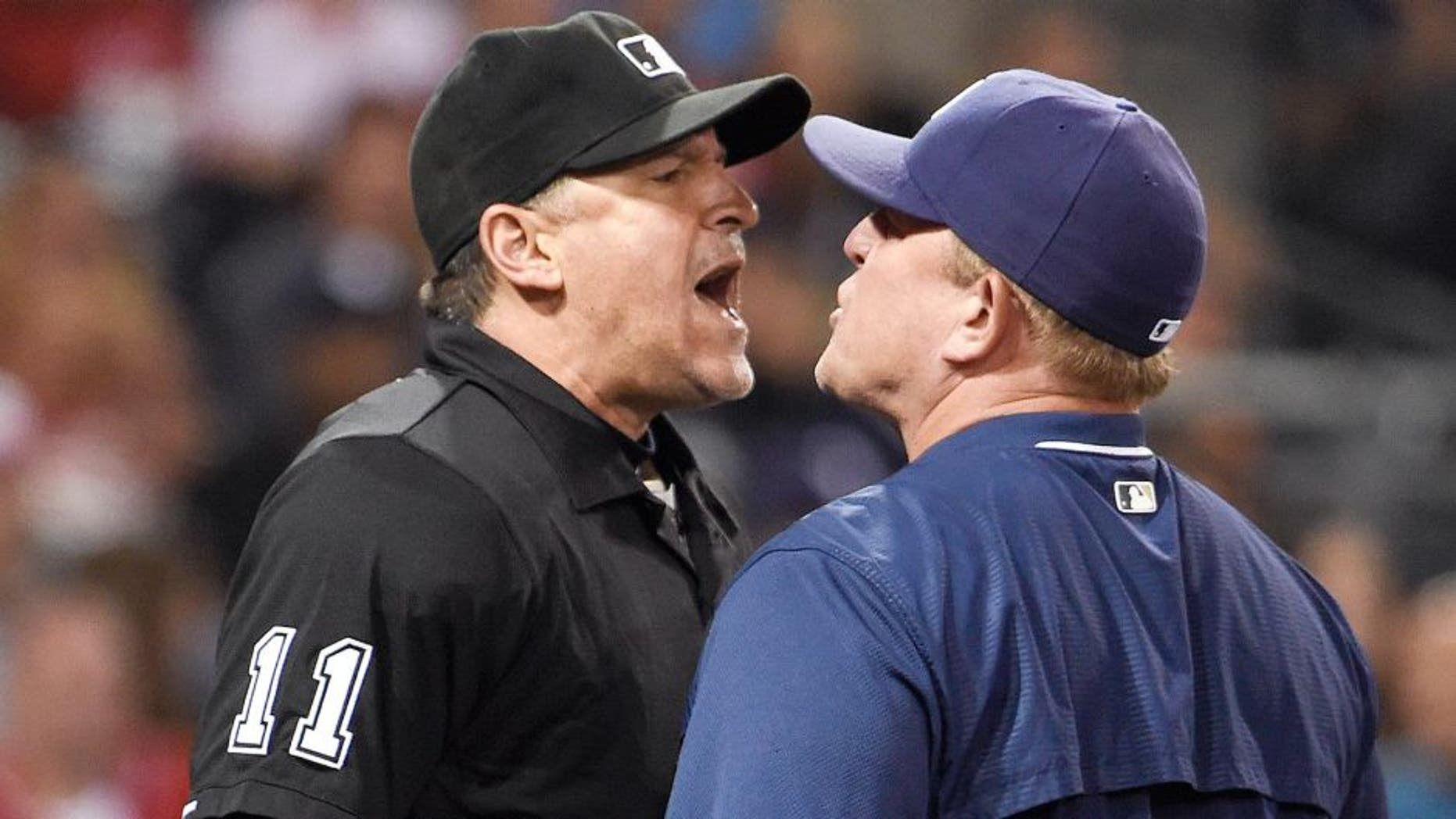 SAN DIEGO, CA - AUGUST 10: Home plate umpire Tony Randazzo and Pat Murphy #24 interim manager of the San Diego Padres argue after Murphy was ejected from the game during the fourth inning of a baseball game against the Cincinnati Reds at Petco Park August 10, 2015 in San Diego, California. (Photo by Denis Poroy/Getty Images)