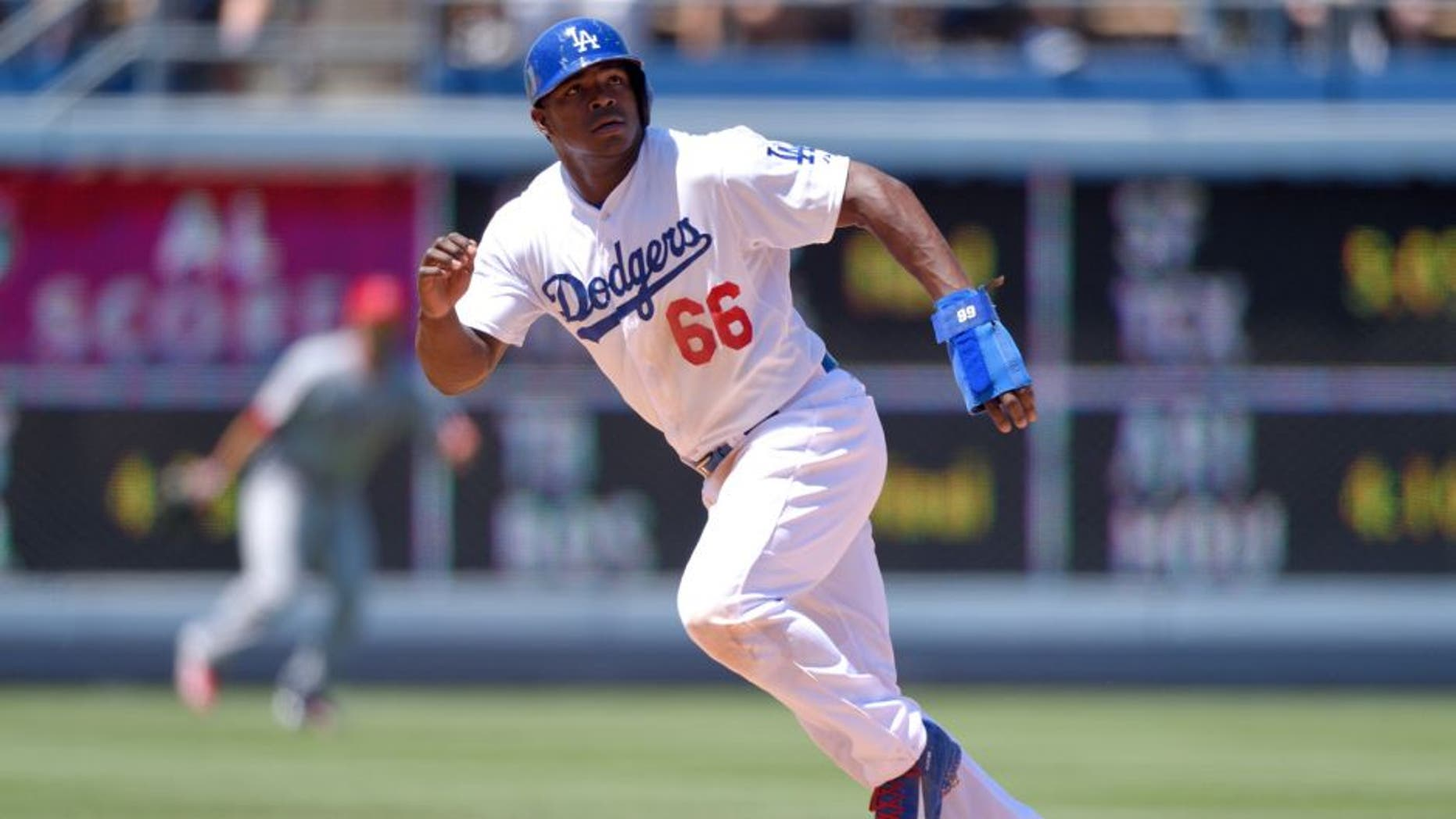 LOS ANGELES, CA - AUGUST 1: Yasiel Puig #66 of the Los Angeles Dodgers runs during the game against the Los Angeles Angels of Anaheim at Dodger Stadium on August 1, 2015 in Los Angeles, California. (Photo by Matt Brown/Angels Baseball LP/Getty Images)