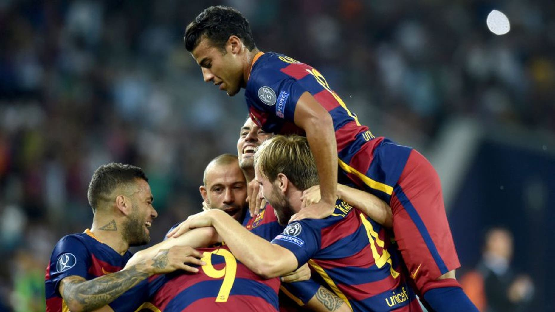 Barcelona's players celebrate after scoring a goal during the UEFA Super Cup final football match between FC Barcelona and Sevilla FC in Tbilisi on August 11, 2015. AFP PHOTO/KIRILL KUDRYAVTSEV (Photo credit should read KIRILL KUDRYAVTSEV/AFP/Getty Images)