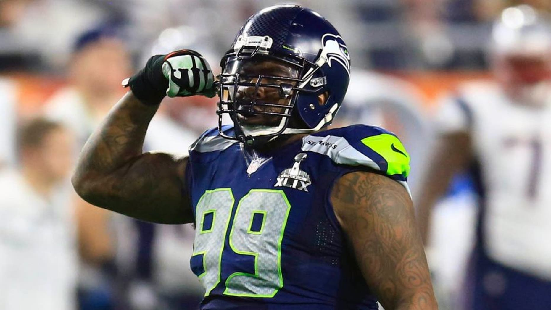 Feb 1, 2015; Glendale, AZ, USA; Seattle Seahawks defensive tackle Tony McDaniel (99) reacts after a play aNew England Patriots during the third quarter in Super Bowl XLIX at University of Phoenix Stadium. Mandatory Credit: Andrew Weber-USA TODAY Sports