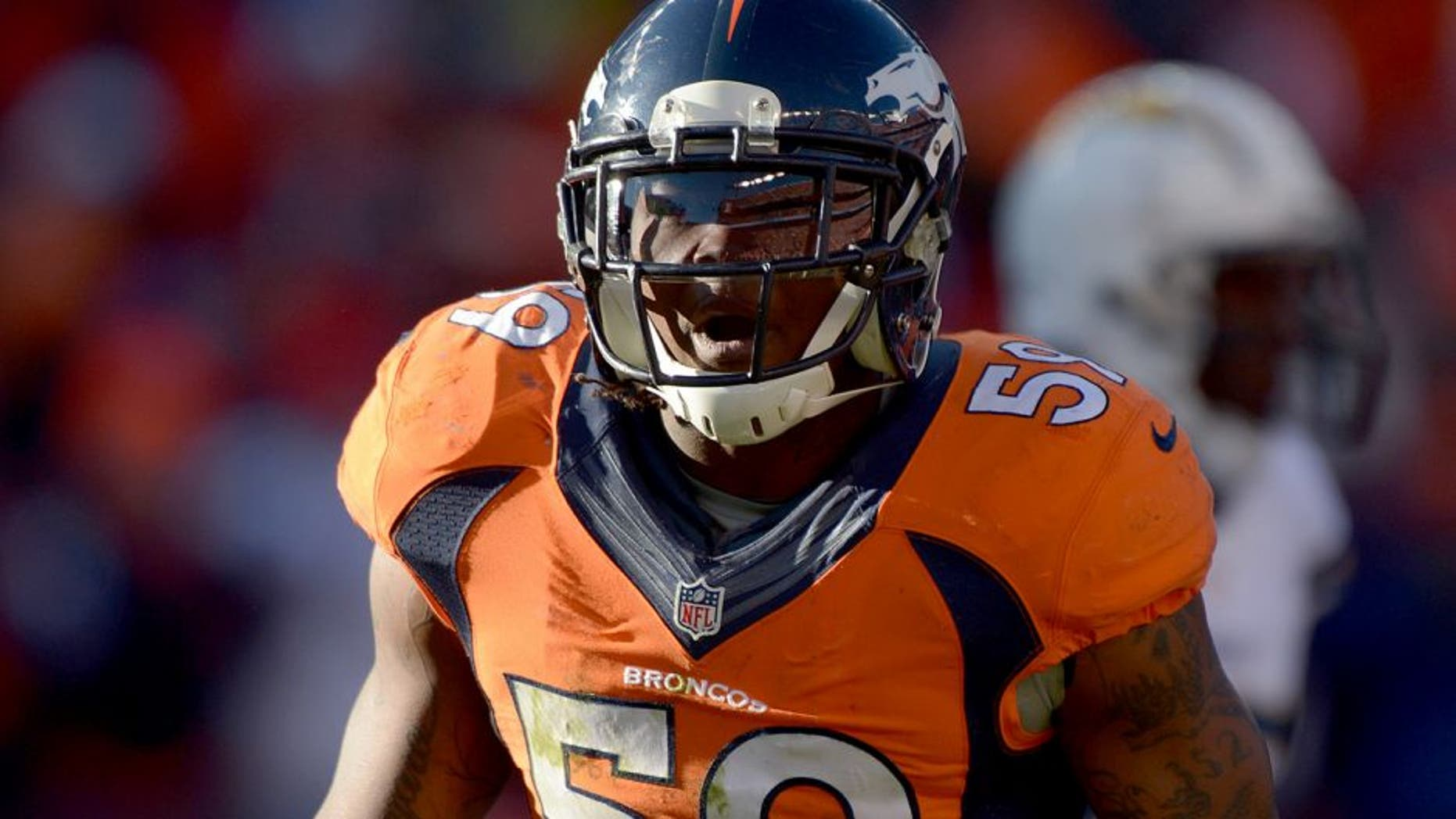 Jan 12, 2014; Denver, CO, USA; Denver Broncos linebacker Danny Trevathan (59) during the 2013 AFC divisional playoff football game against the San Diego Chargers at Sports Authority Field at Mile High. Mandatory Credit: Kirby Lee-USA TODAY Sports
