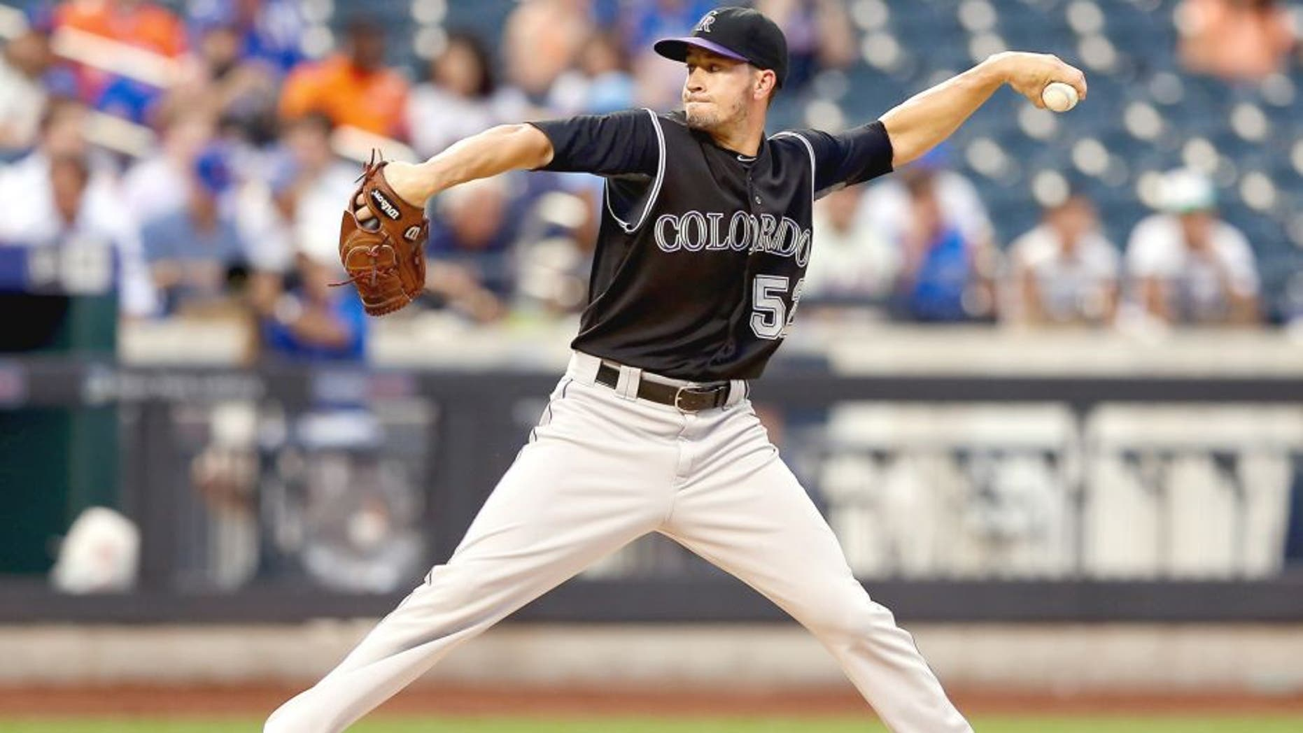 NEW YORK, NY - AUGUST 11: Chris Rusin #52 of the Colorado Rockies delivers a pitch in the first inning against the New York Mets on August 11, 2015 at Citi Field in the Flushing neighborhood of the Queens borough of New York City. (Photo by Elsa/Getty Images)