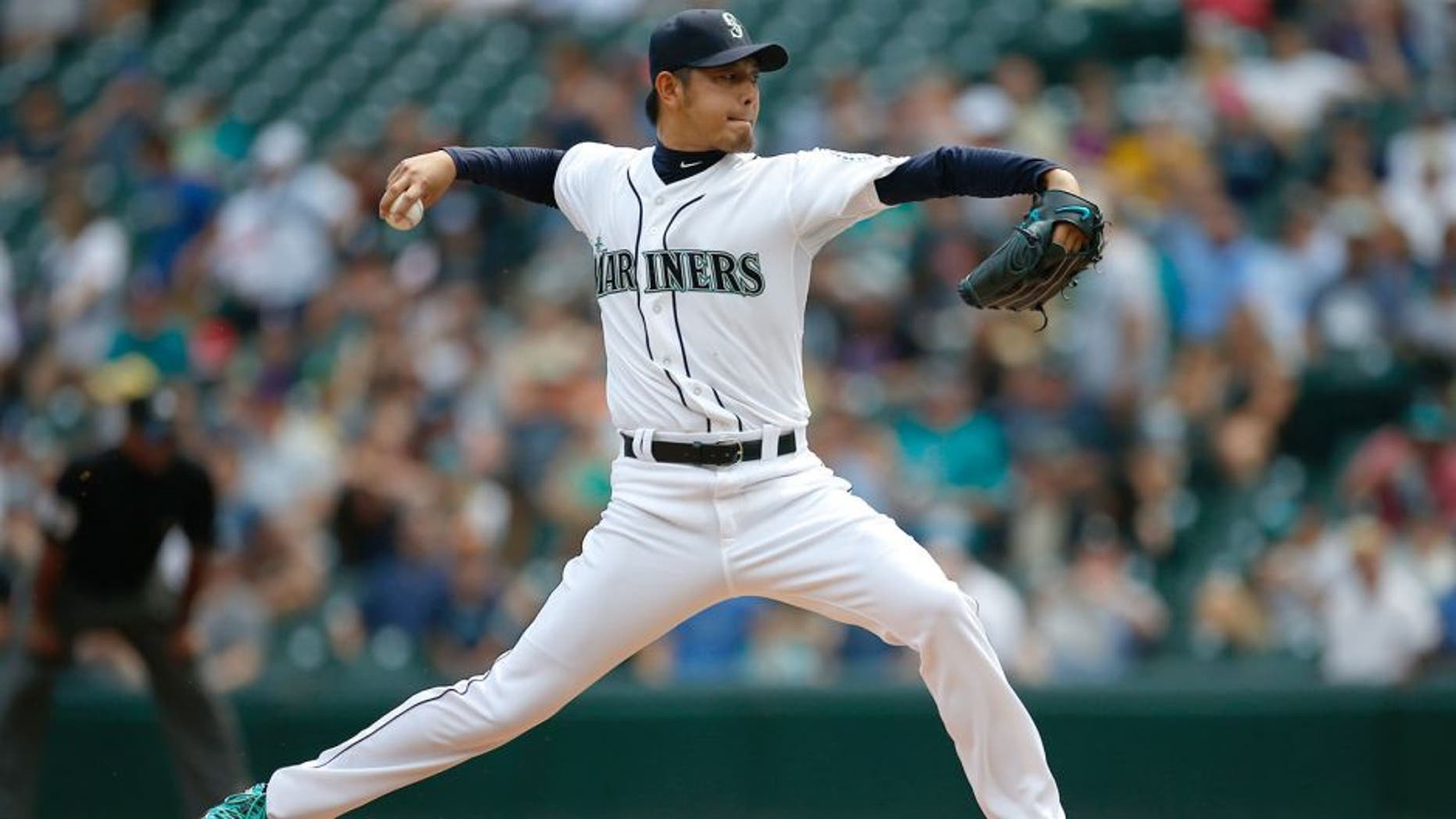 SEATTLE, WA - AUGUST 12: Starting pitcher Hisashi Iwakuma #18 of the Seattle Mariners pitches against the Baltimore Orioles in the first inning at Safeco Field on August 12, 2015 in Seattle, Washington. (Photo by Otto Greule Jr/Getty Images)