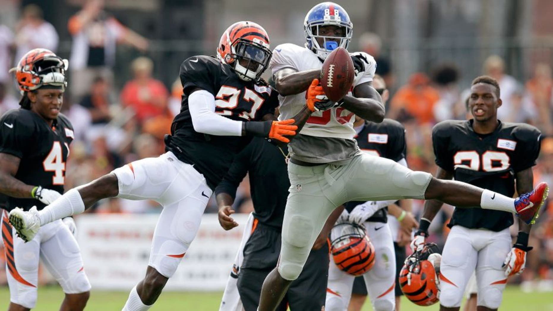 Cincinnati Bengals cornerback Dre Kirkpatrick (27) blocks a pass to New York Giants wide receiver Corey Washinton during NFL football training camp, Tuesday, Aug. 11, 2015, in Cincinnati. (AP Photo/John Minchillo)