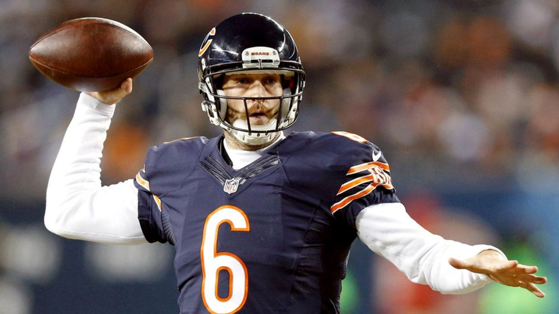 CHICAGO, IL - DECEMBER 4: Jay Cutler #6 of the Chicago Bears passes the ball against the Dallas Cowboys during the game at Soldier Field on December 4, 2014 in Chicago, Illinios. The Cowboys defeated the Bears 41-28. (Photo by Joe Robbins/Getty Images)