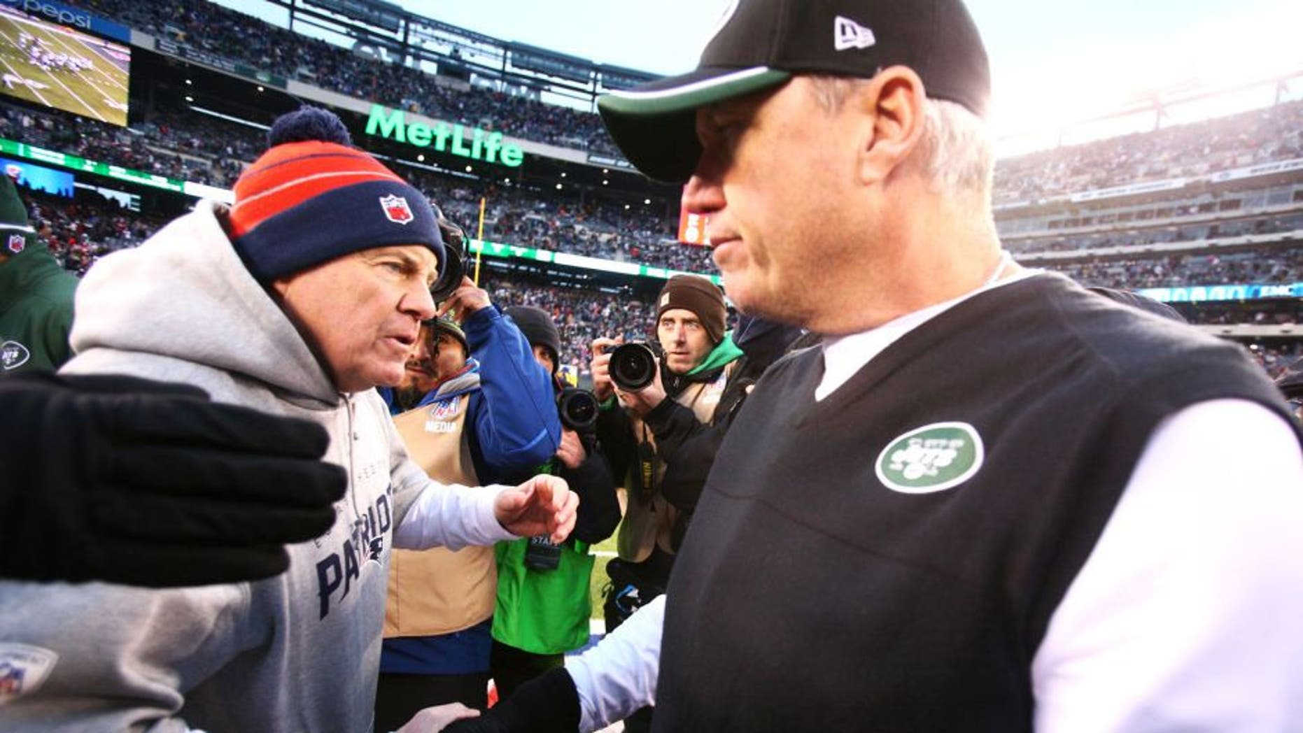 Dec 21, 2014; East Rutherford, NJ, USA; New England Patriots head coach Bill Belichick (left) shakes hands with New York Jets head coach Rex Ryan after a game at MetLife Stadium. The Patriots defeated the Jets 17-16. Mandatory Credit: Brad Penner-USA TODAY Sports