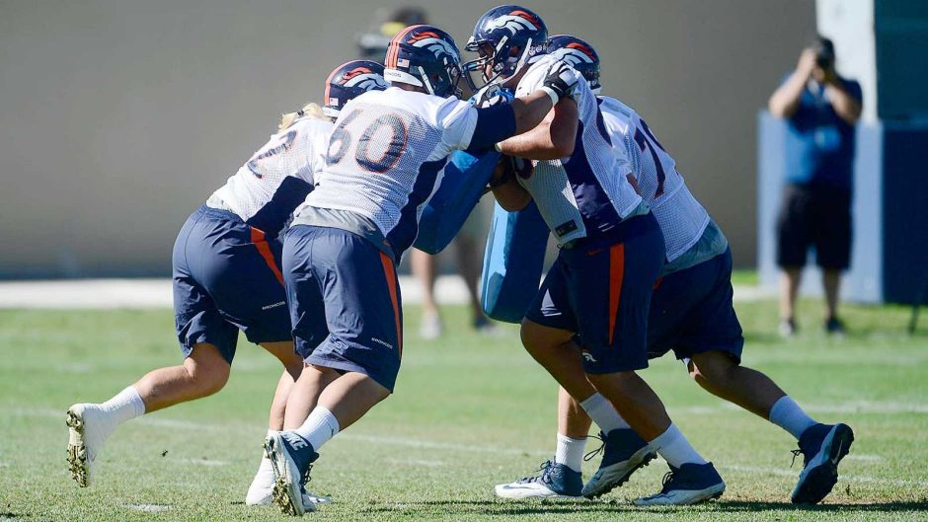 Aug 12, 2015; Englewood, CO, USA; Denver Broncos center Dillon Day (62), guard Andre Davis (60), tackle Louis Vasquez (65) and tackle Michael Schofield (79) pad train during training camp activities at the UCHealth Training Center. Mandatory Credit: Ron Chenoy-USA TODAY Sports