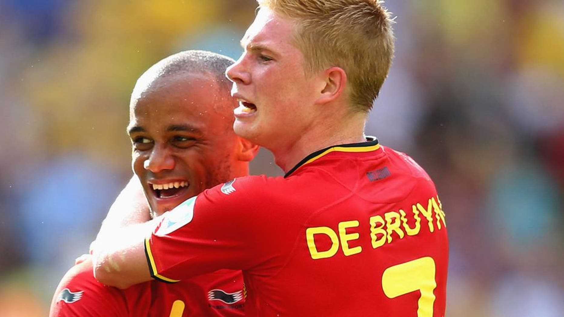 RIO DE JANEIRO, BRAZIL - JUNE 22: Vincent Kompany and Kevin De Bruyne of Belgium celebrate during the 2014 FIFA World Cup Brazil Group H match between Belgium and Russia at Maracana on June 22, 2014 in Rio de Janeiro, Brazil. (Photo by Julian Finney/Getty Images)