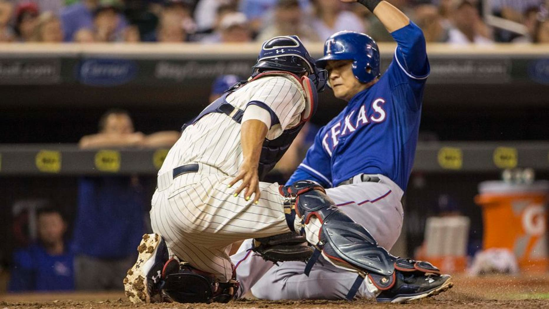 Aug 12, 2015; Minneapolis, MN, USA; Minnesota Twins catcher Kurt Suzuki (8) tags out Texas Rangers right fielder Shin-Soo Choo (17) at home plate in the sixth inning at Target Field. Mandatory Credit: Jesse Johnson-USA TODAY Sports