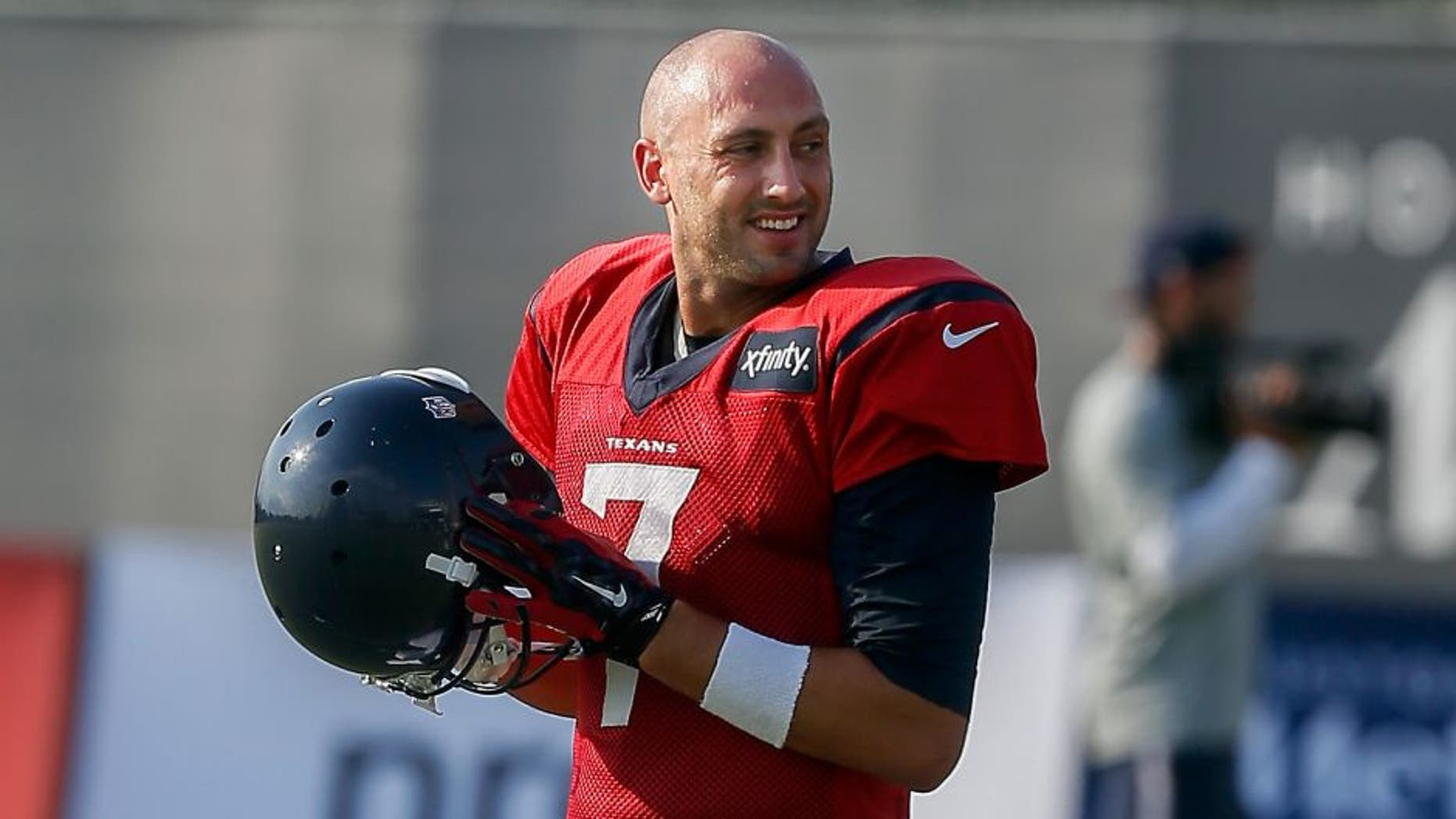 Houston Texans quarterback Brian Hoyer (7) takes the field during an NFL football training camp at the Methodist Training Center on Monday, Aug. 3, 2015 in Houston. (AP Photo/Bob Levey)