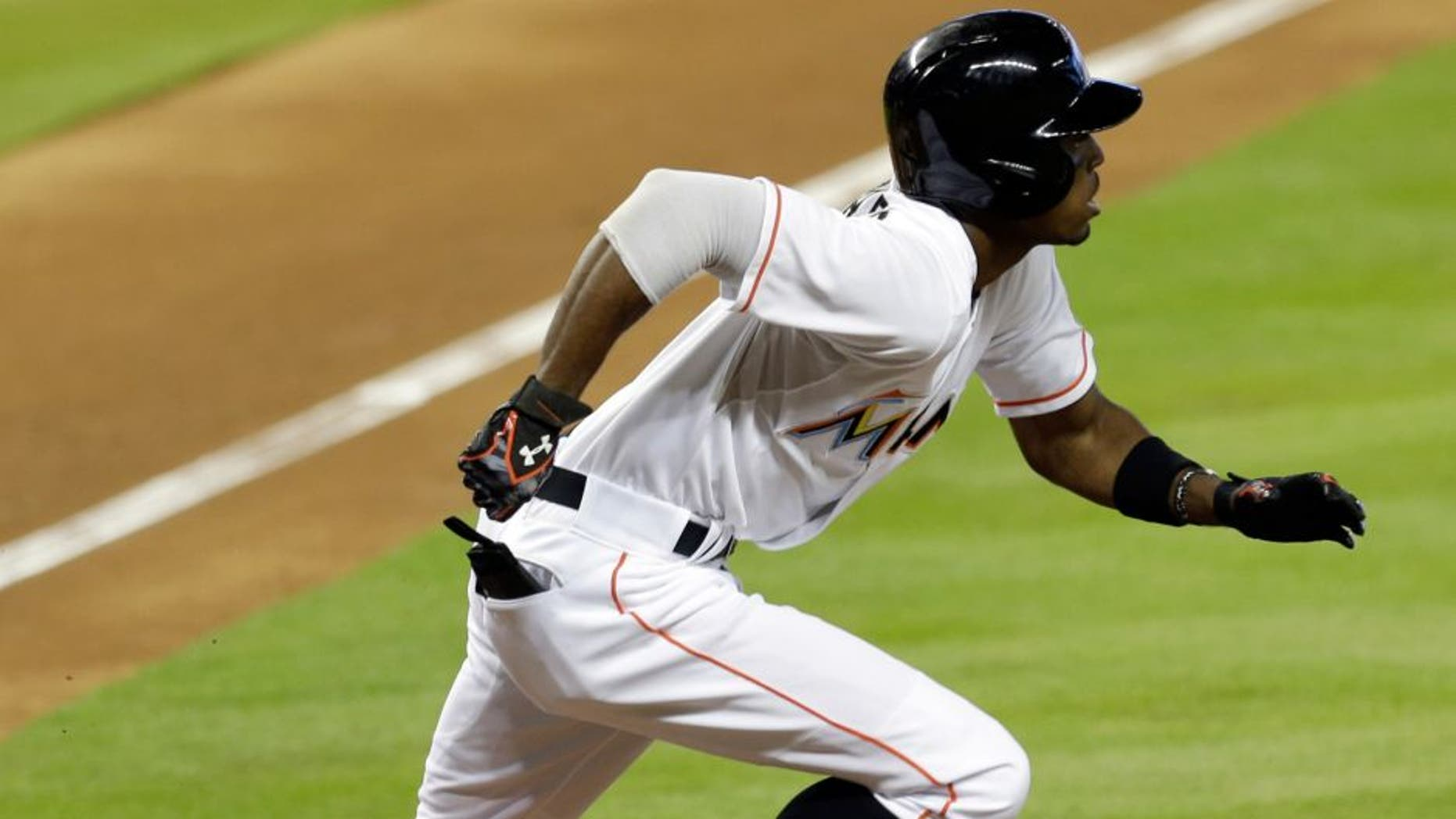 Miami Marlins' Dee Gordon heads to first base after hitting a solo home run against the Boston Red Sox during the first inning of a baseball game, Wednesday, Aug. 12, 2015, in Miami. (AP Photo/Alan Diaz)