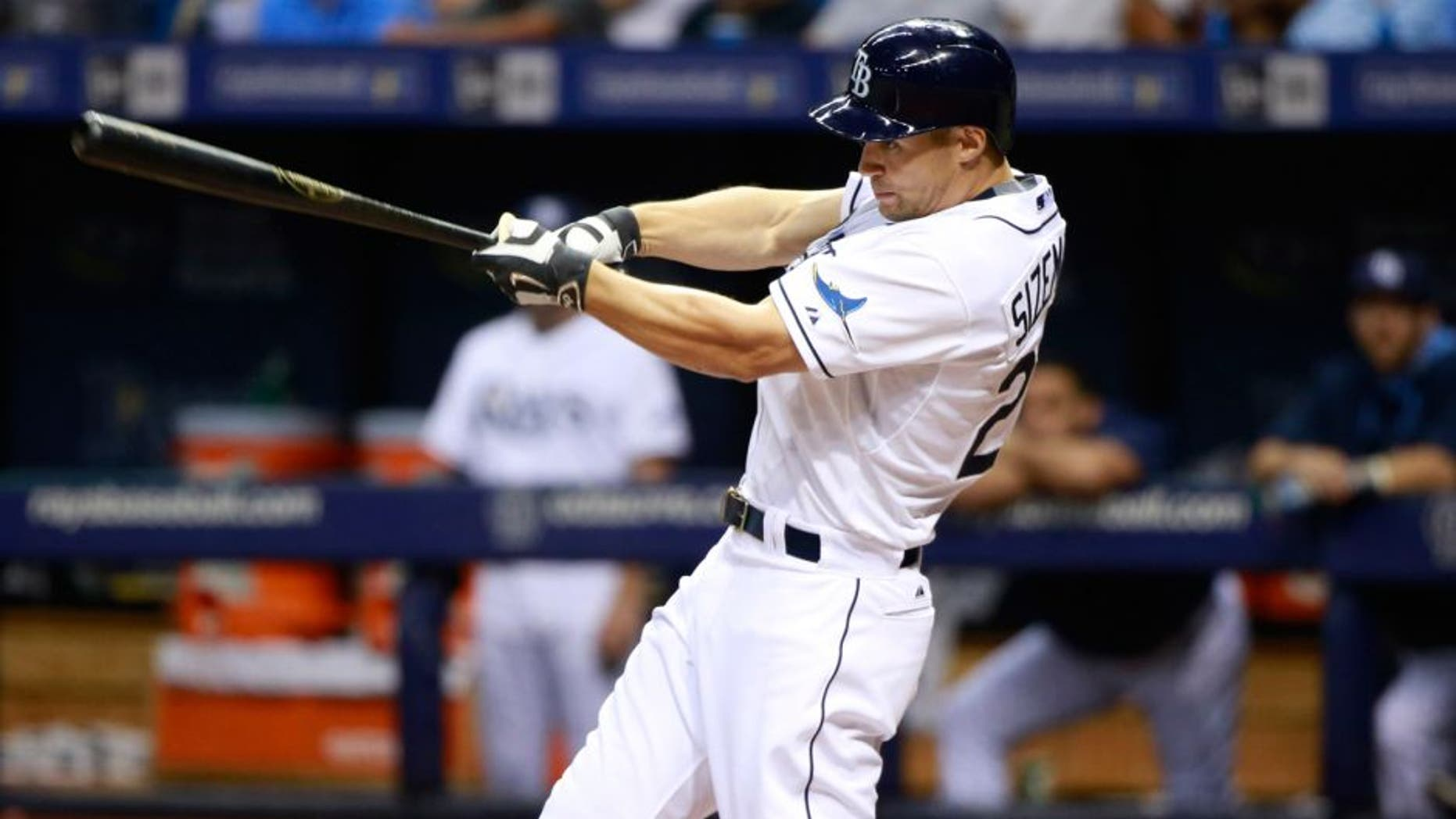 Aug 12, 2015; St. Petersburg, FL, USA; Tampa Bay Rays left fielder Grady Sizemore (24) singles during the third inning against the Atlanta Braves at Tropicana Field. Mandatory Credit: Kim Klement-USA TODAY Sports
