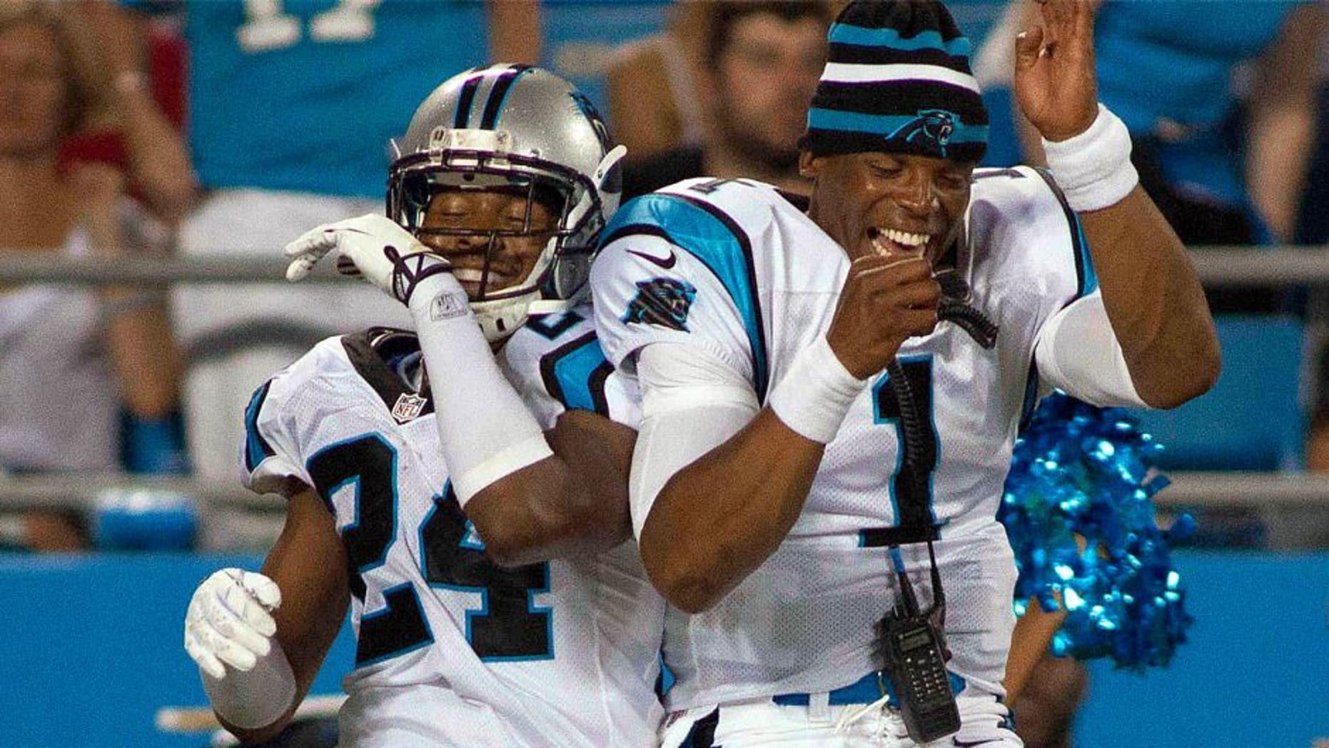 Aug 9, 2013; Charlotte, NC, USA; Carolina Panthers quarterback Cam Newton (1) celebrates with cornerback Josh Norman (24) after scoring a touchdown during the second half against the Chicago Bears. The Panthers defeated the Bears 24-17. Mandatory Credit: Jeremy Brevard-USA TODAY Sports