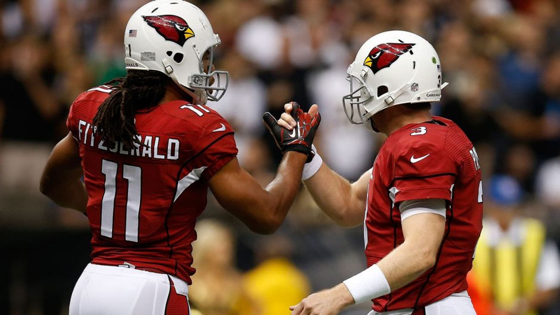 NEW ORLEANS, LA - SEPTEMBER 22: Carson Palmer and Larry Fitzgerald #11 of the Arizona Cardinals celebrate after a touchdown against the New Orleans Saints at the Mercedes-Benz Superdome on September 22, 2013 in New Orleans, Louisiana. (Photo by Chris Graythen/Getty Images)