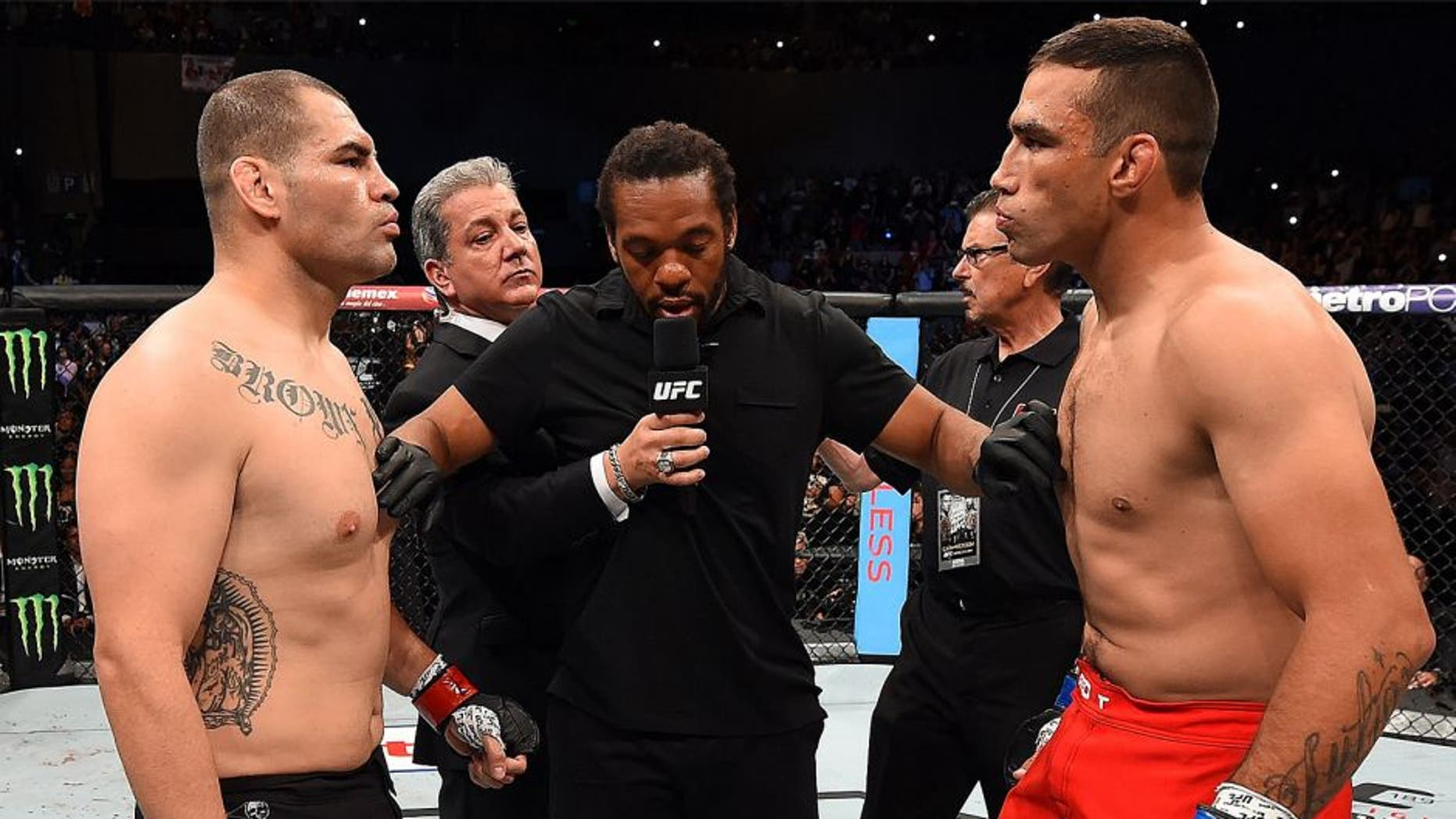 MEXICO CITY, MEXICO - JUNE 13: (L-R) Cain Velasquez of the United States and Fabricio Werdum of Brazil face off before their UFC heavyweight championship bout during the UFC 188 event inside the Arena Ciudad de Mexico on June 13, 2015 in Mexico City, Mexico. (Photo by Josh Hedges/Zuffa LLC/Zuffa LLC via Getty Images)