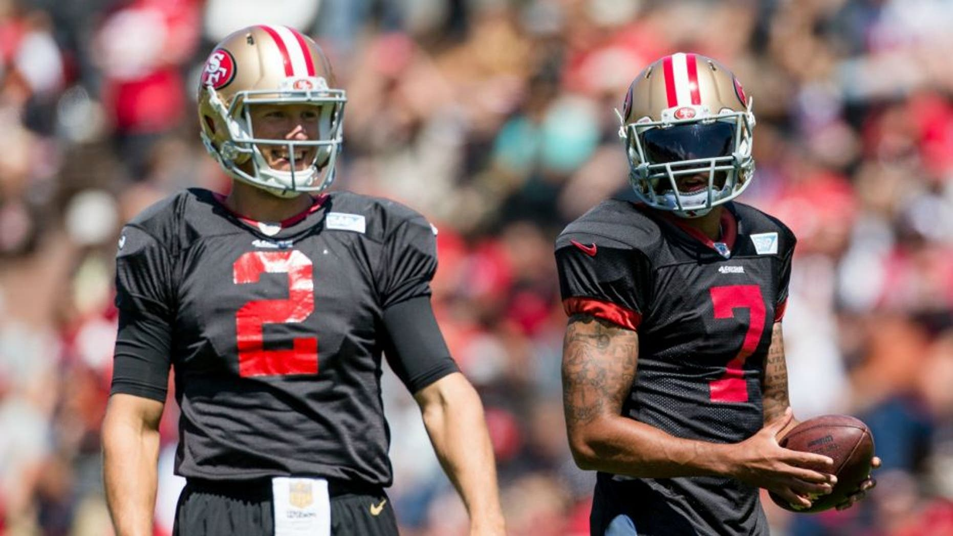 Aug 10, 2016; San Francisco, CA, USA; San Francisco 49ers quarterback Blaine Gabbert (2) and quarterback Colin Kaepernick (7) train at Kezar Stadium. Mandatory Credit: John Hefti-USA TODAY Sports