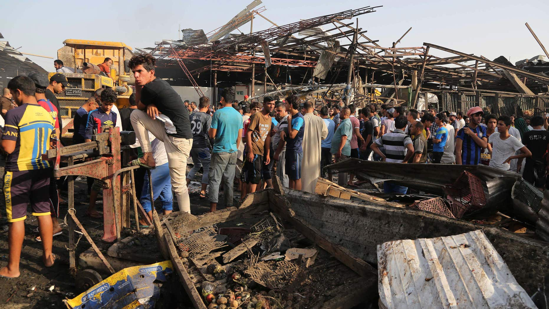 Aug. 13, 2015: Civilians gather at the scene of bomb attack in Jameela market in the Iraqi capital's crowded Sadr City neighborhood Baghdad, Iraq.