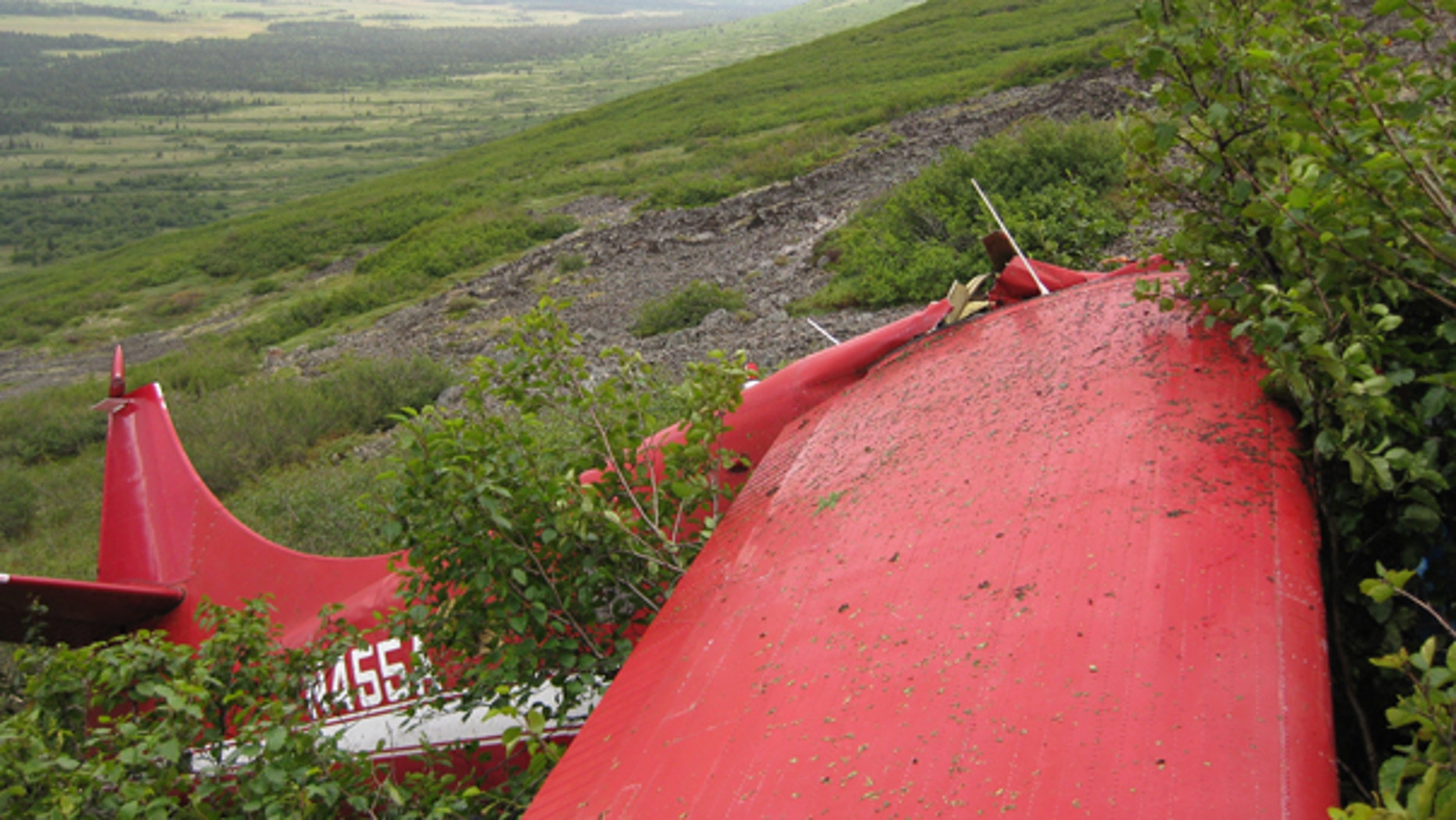 Aug. 11: This photo released by the National Transportation Safety Board shows the wreckage from the aircraft accident which killed former U.S. Senator Ted Stevens and four others, near Aleknagik, Alaska. A sophisticated beacon was registered to the plane that crashed, but it wasn't clear whether it was onboard during the flight.