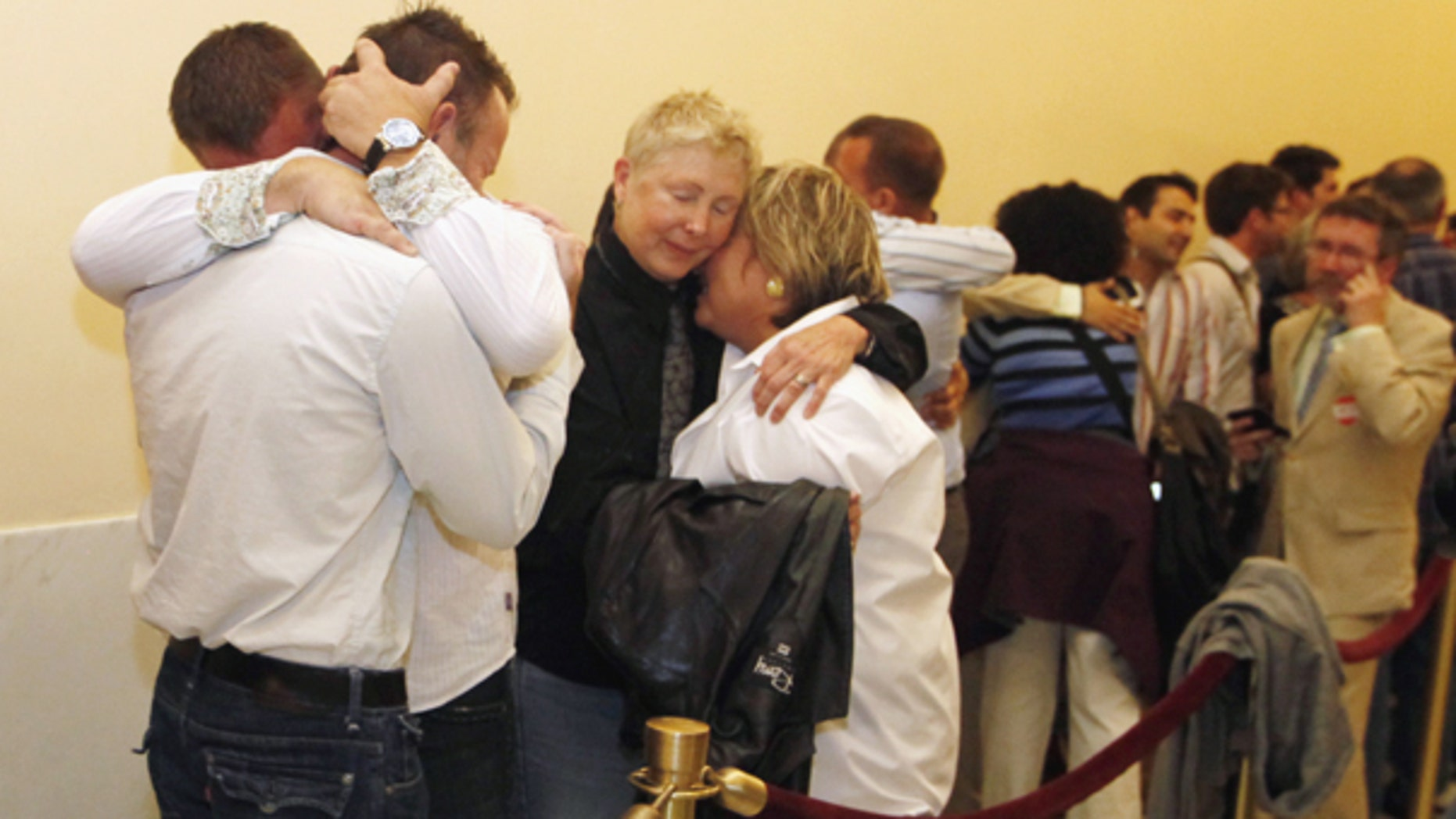 Aug. 12: Same-sex couples waiting in line to be married react to the news that they may not marry for at least another week in San Francisco.