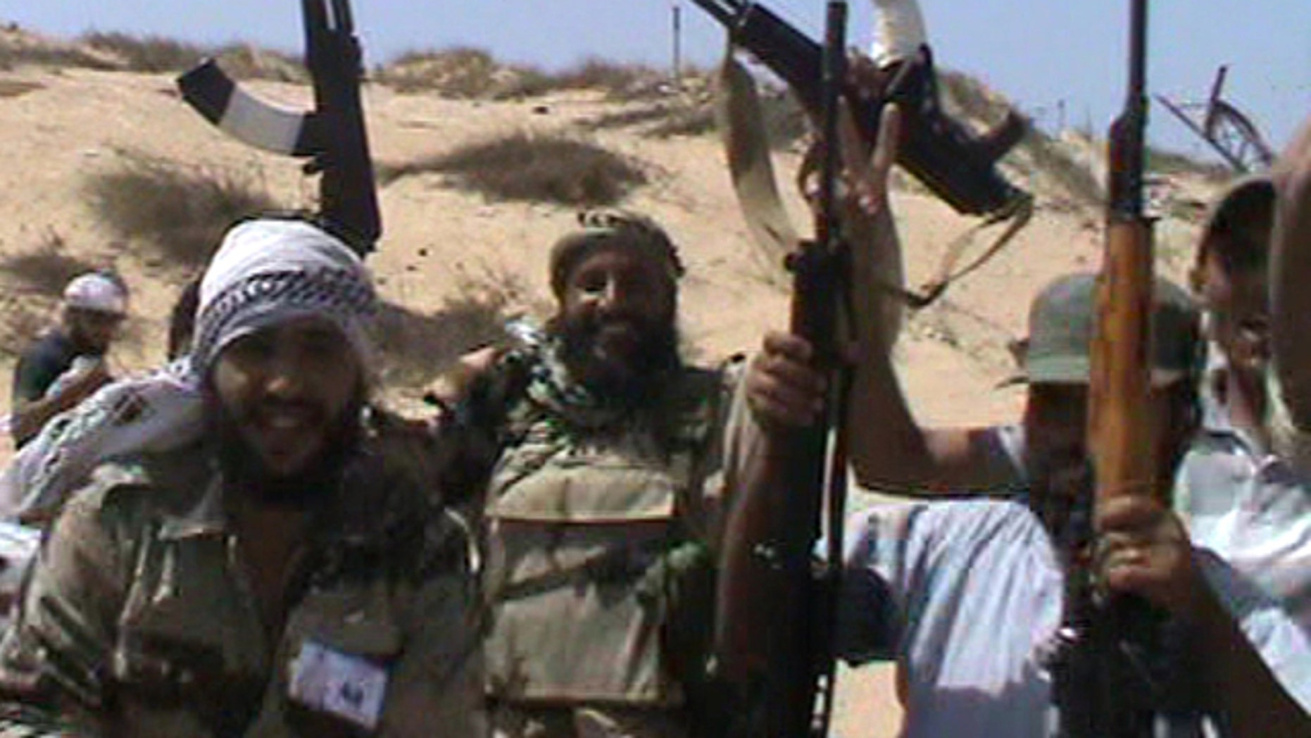 Aug. 12: In this image made from amateur video and accessed by The Associated Press, rebel soldiers celebrate in Brega, Libya.