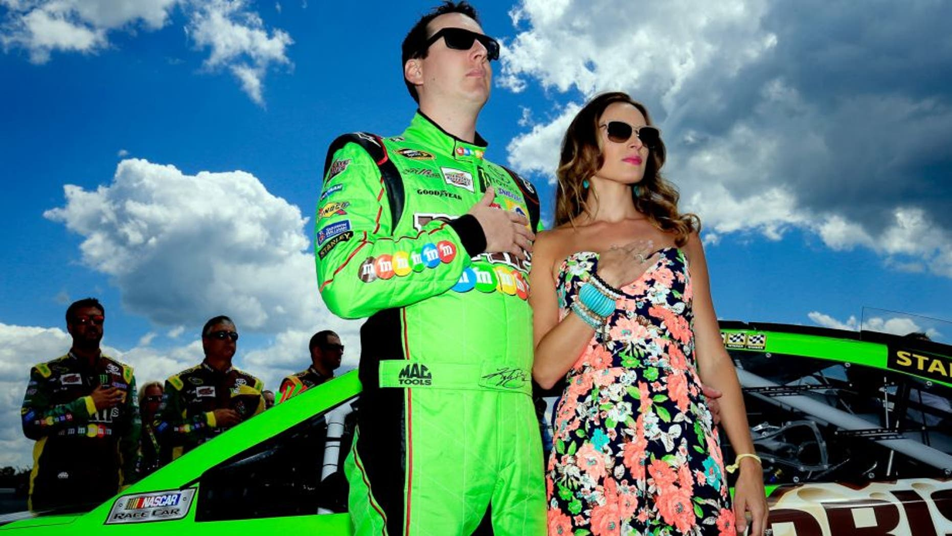 LONG POND, PA - AUGUST 02: Kyle Busch, driver of the #18 M&M's Crispy Toyota, stands with his wife Samantha prior to the NASCAR Sprint Cup Series Windows 10 400 at Pocono Raceway on August 2, 2015 in Long Pond, Pennsylvania. (Photo by Chris Trotman/Getty Images)