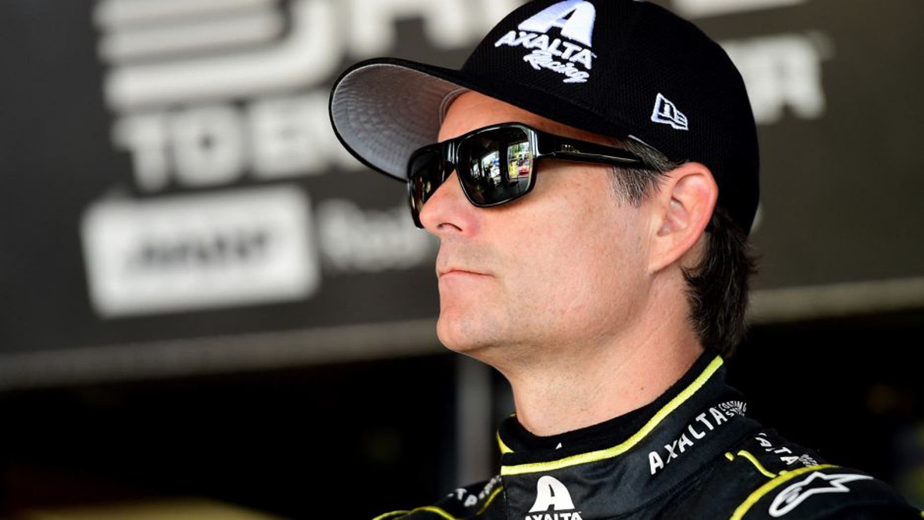 WATKINS GLEN, NY - AUGUST 07: Jeff Gordon, driver of the #24 Axalta Chevrolet, stands in the garage area during practice for the NASCAR Sprint Cup Series Cheez-It 355 at Watkins Glen International on August 7, 2015 in Watkins Glen, New York. (Photo by Jared C. Tilton/NASCAR via Getty Images)