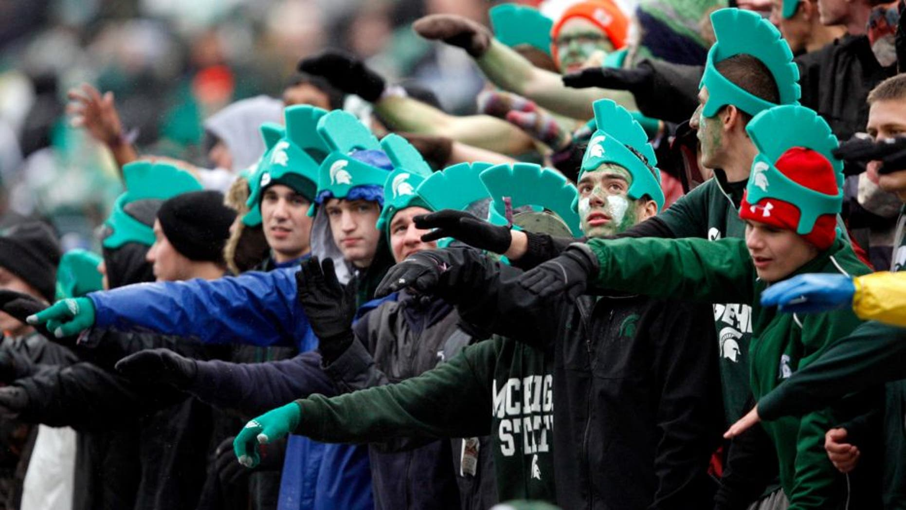 Nov 2, 2013; East Lansing, MI, USA; Michigan State Spartans fans cheer during the first quarter against the Michigan Wolverines at Spartan Stadium. Mandatory Credit: Raj Mehta-USA TODAY Sports